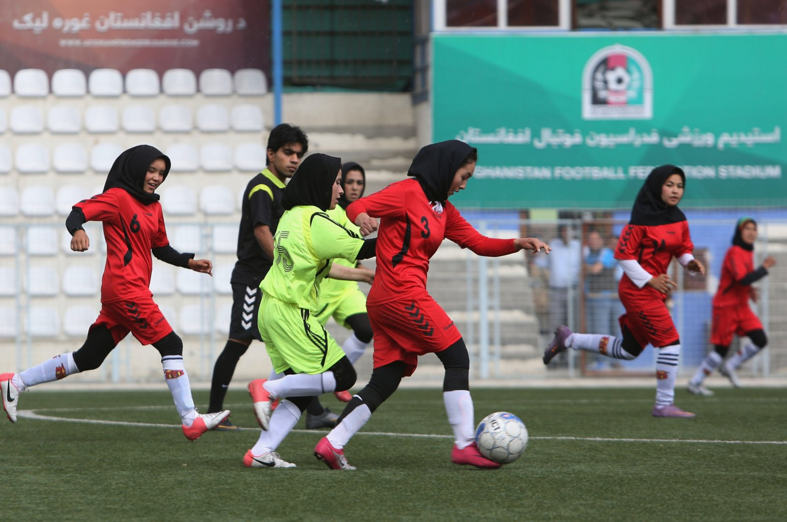 Afghan female footballers participate in a match to prepare for Afghanistan's first female football premier league, in Kabul, Afghanistan, June 2, 2014. (AP Photo)