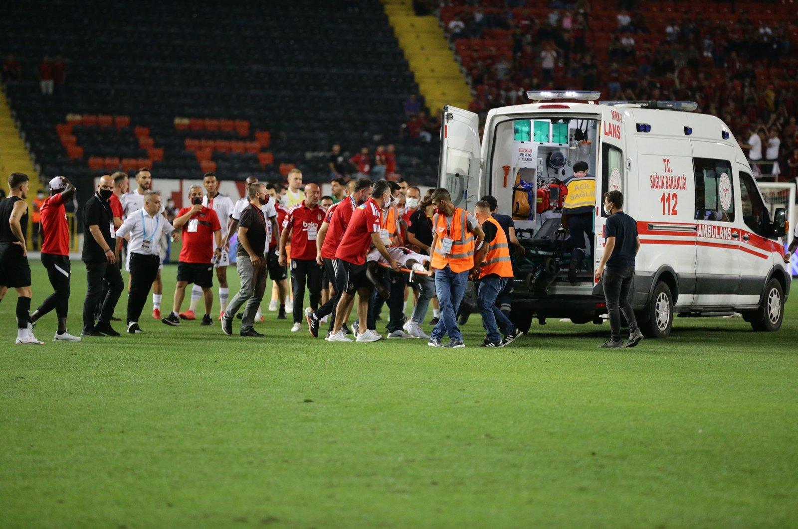 Beşiktaş defender Fabrice N'Sakala is carried on stretcher to an ambulance after his collapse during Beşiktaş match against Gaziantep in Turkish Süper Lig, at Kalyon Stadium, Gaziantep, Turkey, Aug. 21, 2021. (AA Photo)