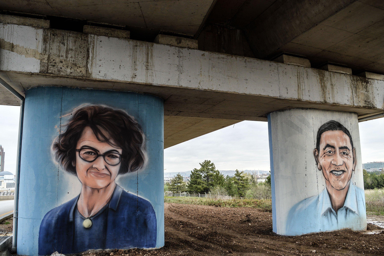 Graffiti portraits of scientists Uğur Şahin (R) and Özlem Türeci, who created the BioNTech coronavirus vaccine with Pfizer, in Ankara, Turkey. (Getty Images)