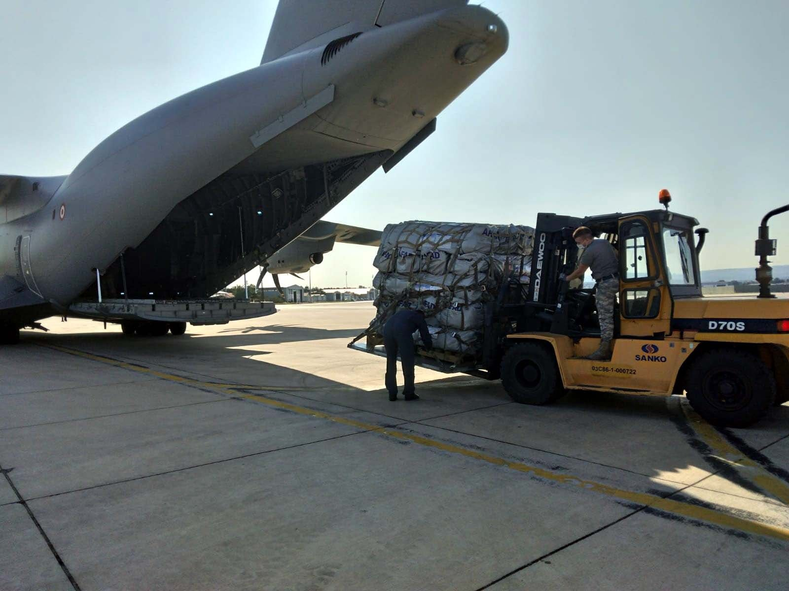 Aid packages are being loaded onto the plane, in the capital Ankara, Turkey, Aug. 23, 2021. (DHA Photo)