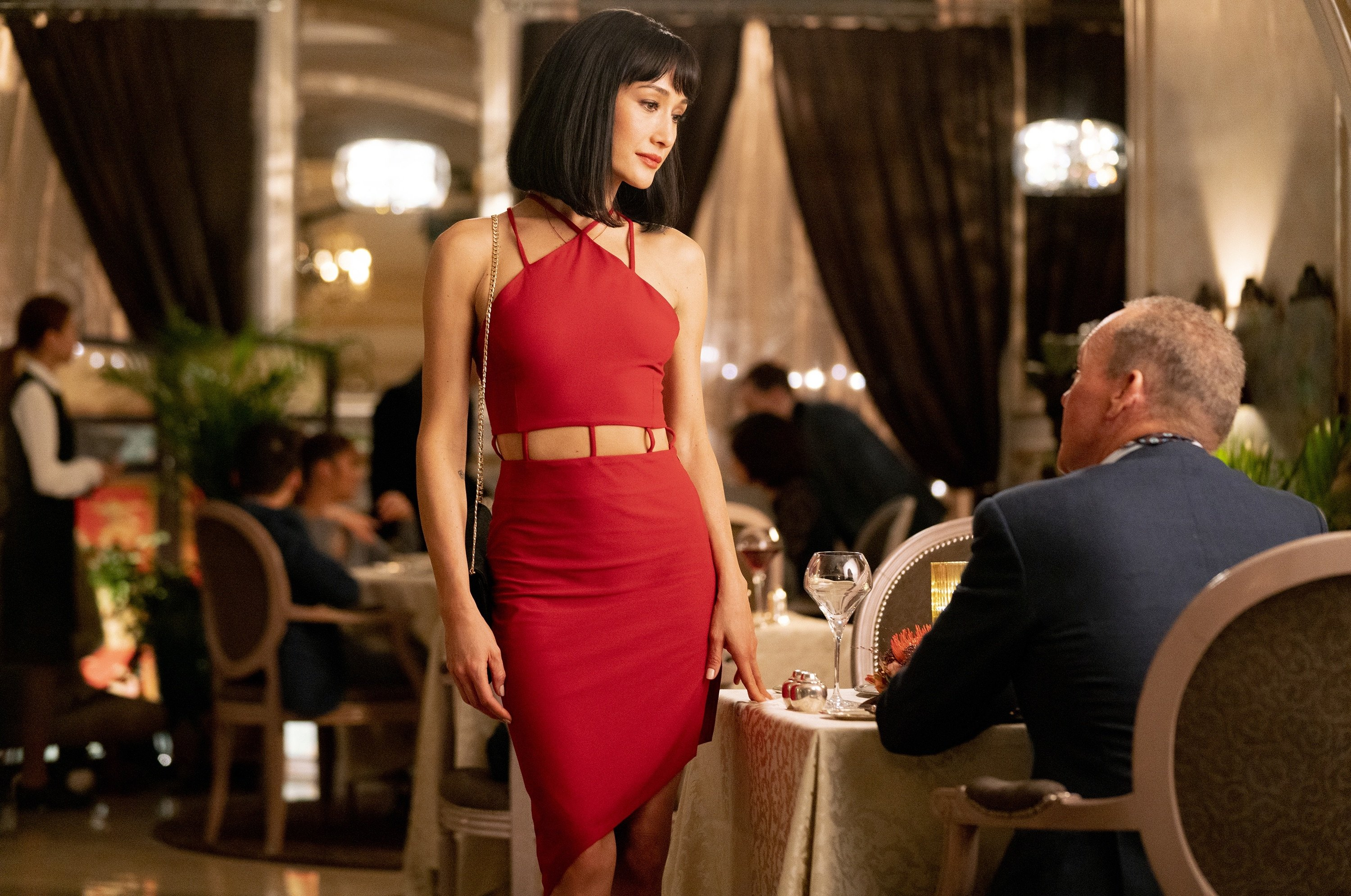 """Maggie Q (C) as Anna, in a scene from the film """"The Protege."""" (Lionsgate via AP)"""