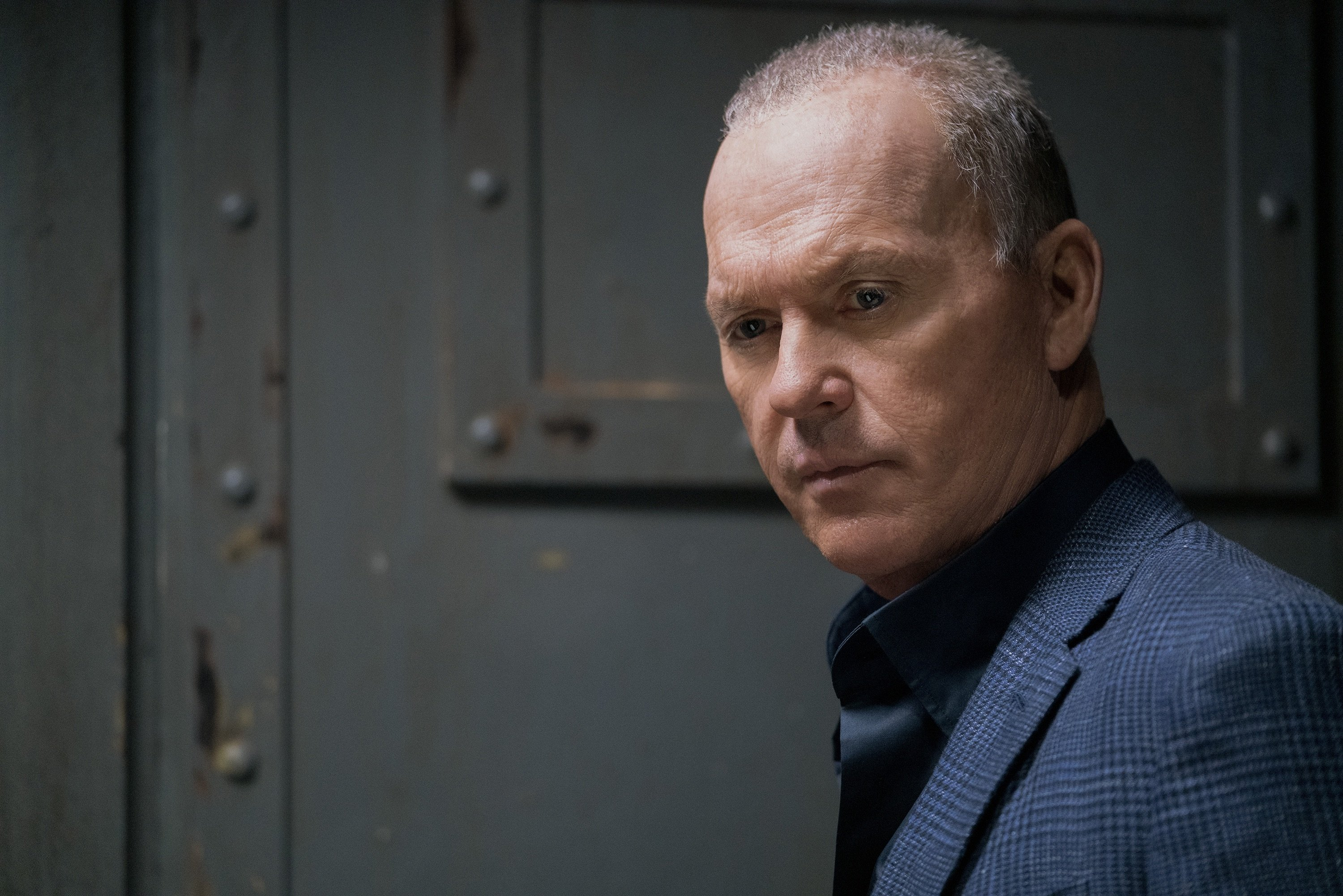 """Michael Keaton as Rembrandt, in a scene from the film """"The Protege."""" (Lionsgate via AP)"""