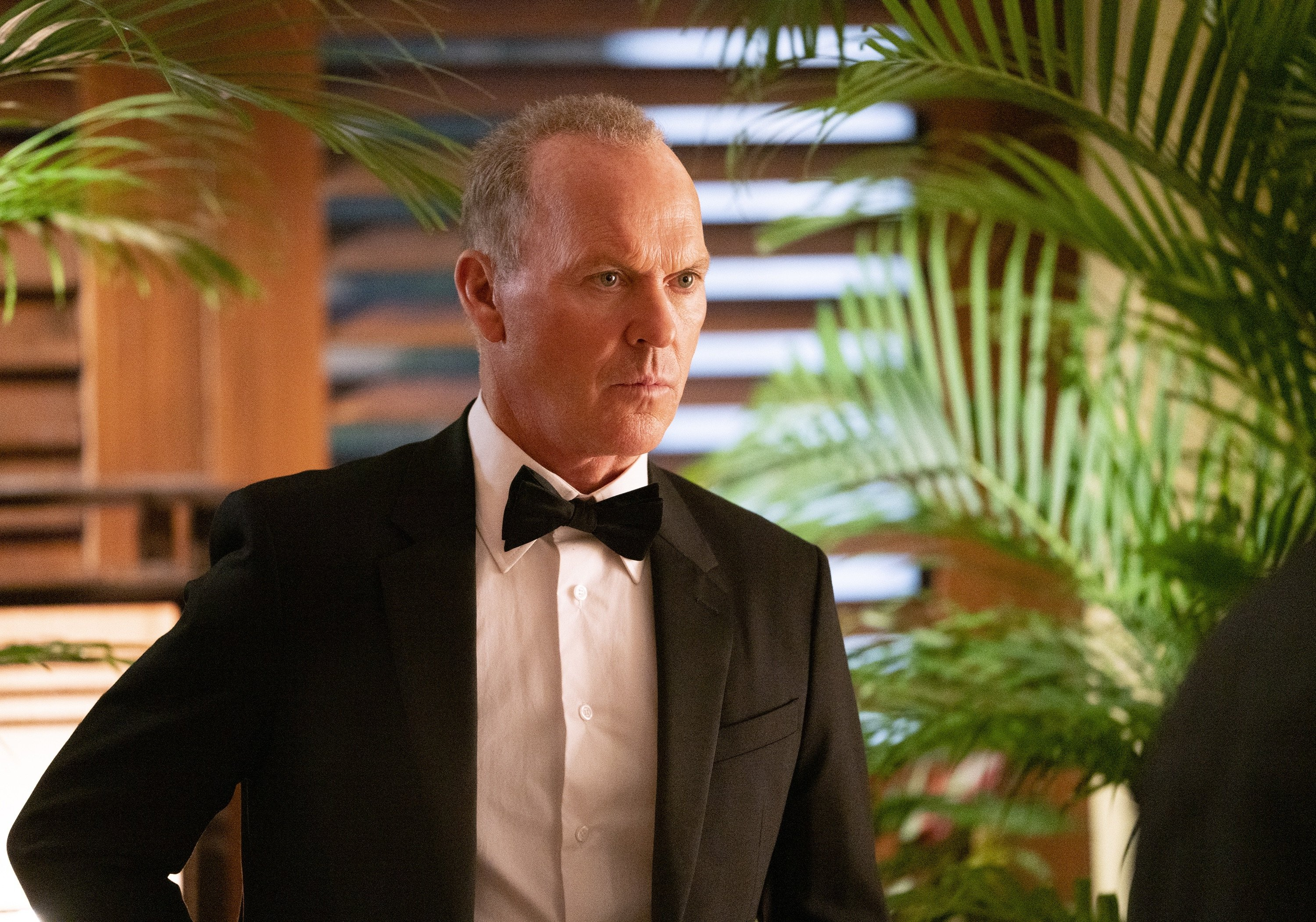 """Michael Keaton as Rembrandt,in a scene from the film """"The Protege."""" (Lionsgate via AP)"""