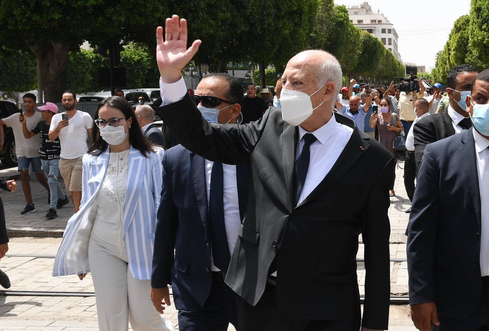 President Kais Saied (C) gesturing as he walks protected by security while touring Habib Bourguiba avenue in the center of Tunis, Tunisia, Aug. 1, 2021. (AFP Photo)