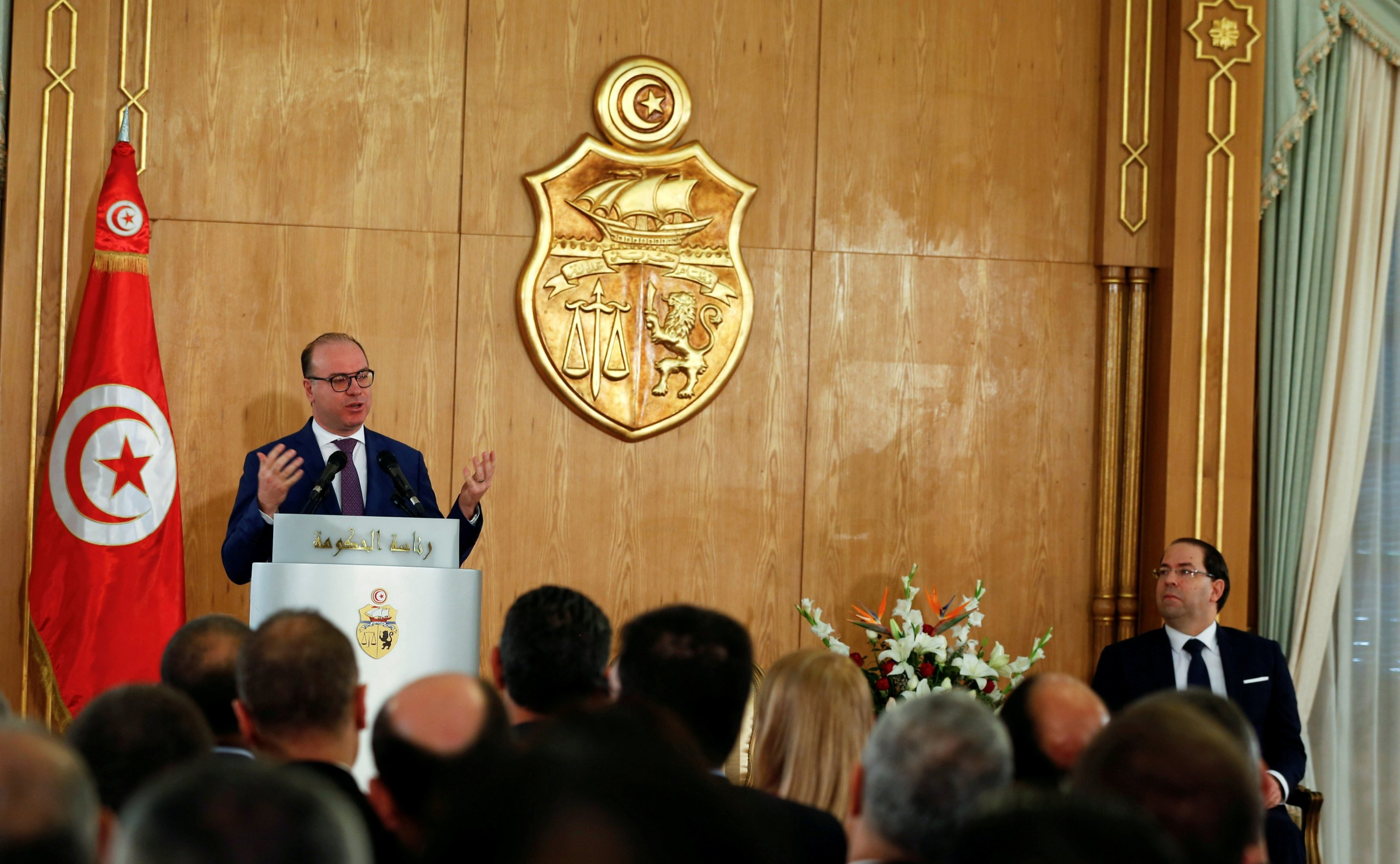 Tunisia's Prime Minister Elyes Fakhfakh speaks next to his predecessor Youssef Chahed during a handover ceremony in Tunis, Tunisia, Feb. 28, 2020. (REUTERS Photo)