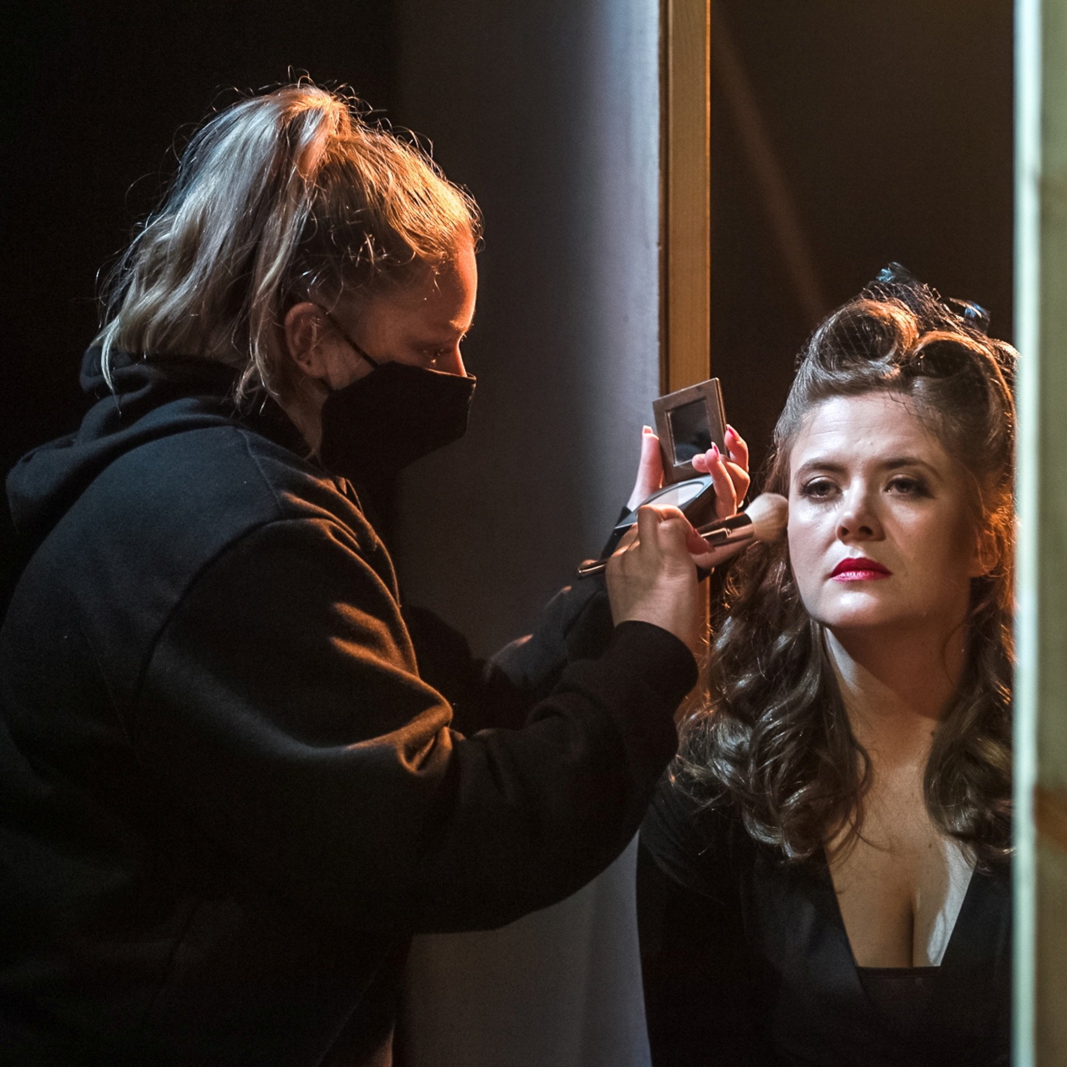 """Actor and artistic director of Black Box Live Joanne Hartstone prepares backstage during a rehearsal of """"The Girl Who Jumped Off The Hollywood Sign"""" at the Bakehouse Theatre in Adelaide, Australia, Aug. 11, 2021. (Black Box Live via Reuters)"""