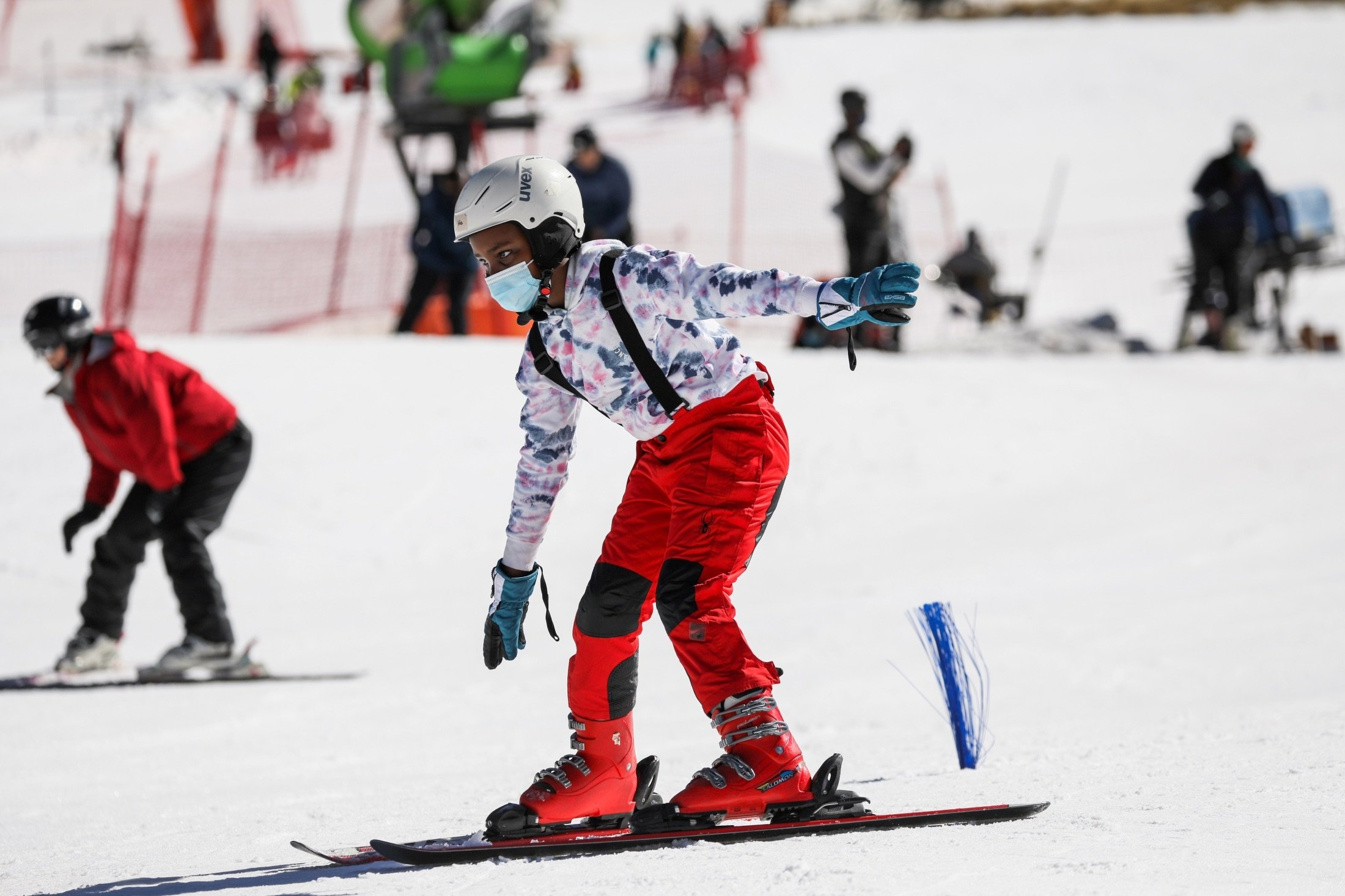 A young skier tries to stay upright during a ski lesson with Hope Ramokotjo at Kapoko Snow Park at Afriski Mountain Resort in Butha Buthe, Lesotho, July 31, 2021. (Reuters Photo)