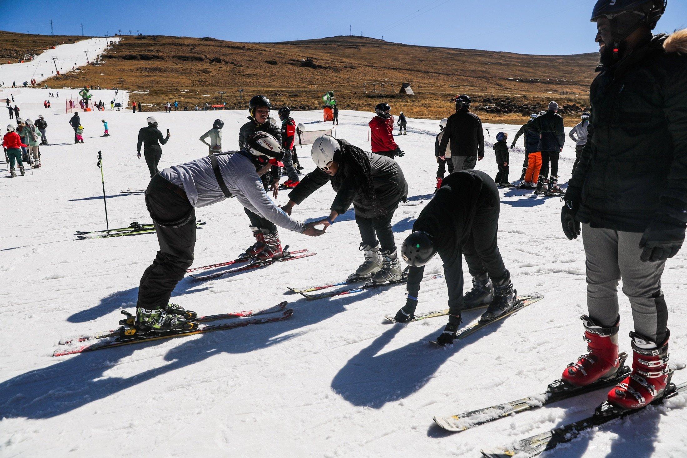 Hope Ramokotjo gives a ski lesson at Kapoko Snow Park at Afriski Mountain Resort in Butha Buthe, Lesotho, July 31, 2021. (Reuters Photo)