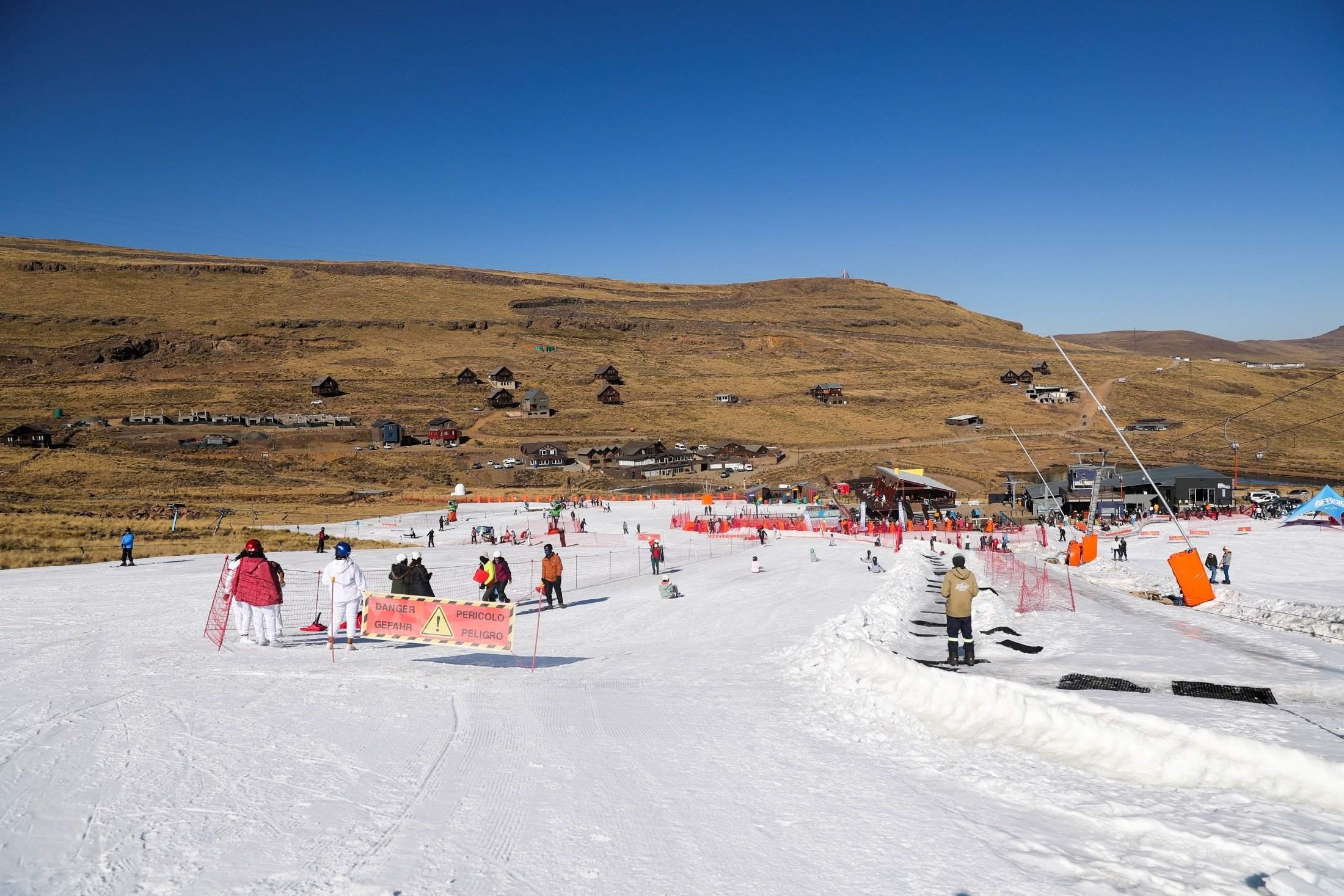 People ski and snowboard at Kapoko Snow Park at Afriski Mountain Resort in Butha Buthe, Lesotho, July 31, 2021. (Reuters Photo)
