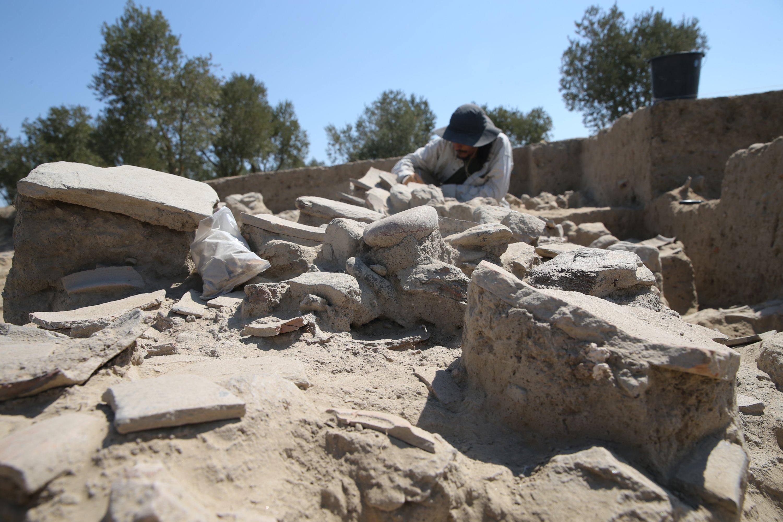 An archaeologist work in the area of the oven in Tepecik Mound, Aydın, western Turkey, Aug. 23, 2021. (AA Photo)