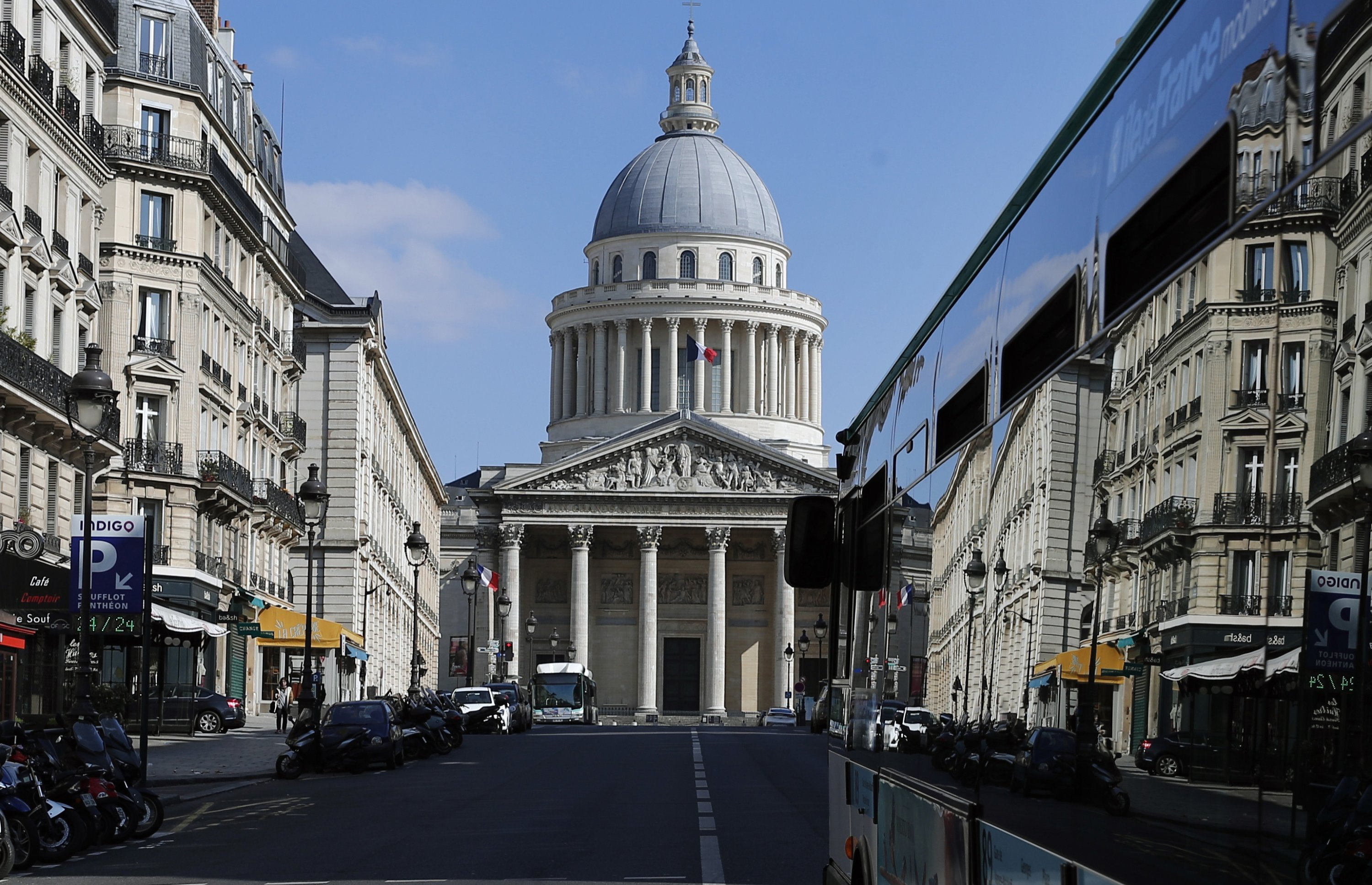 A bus drives to the Pantheon in Paris, France, March 31, 2020. (AP Photo)