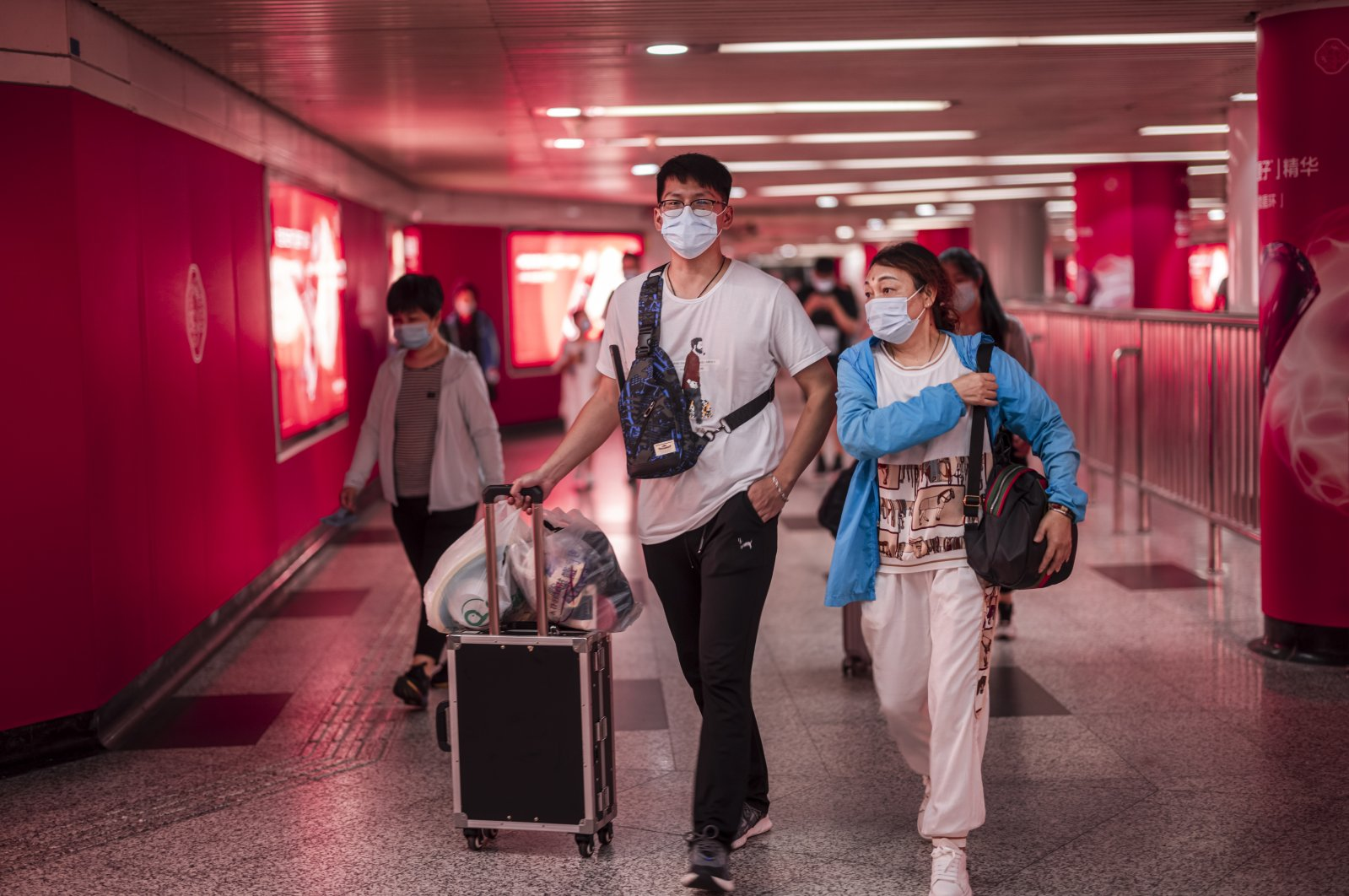 People enter form the subway station to the Pudong International Airport in Shanghai, China, Aug. 22, 2021. (EPA Photo)