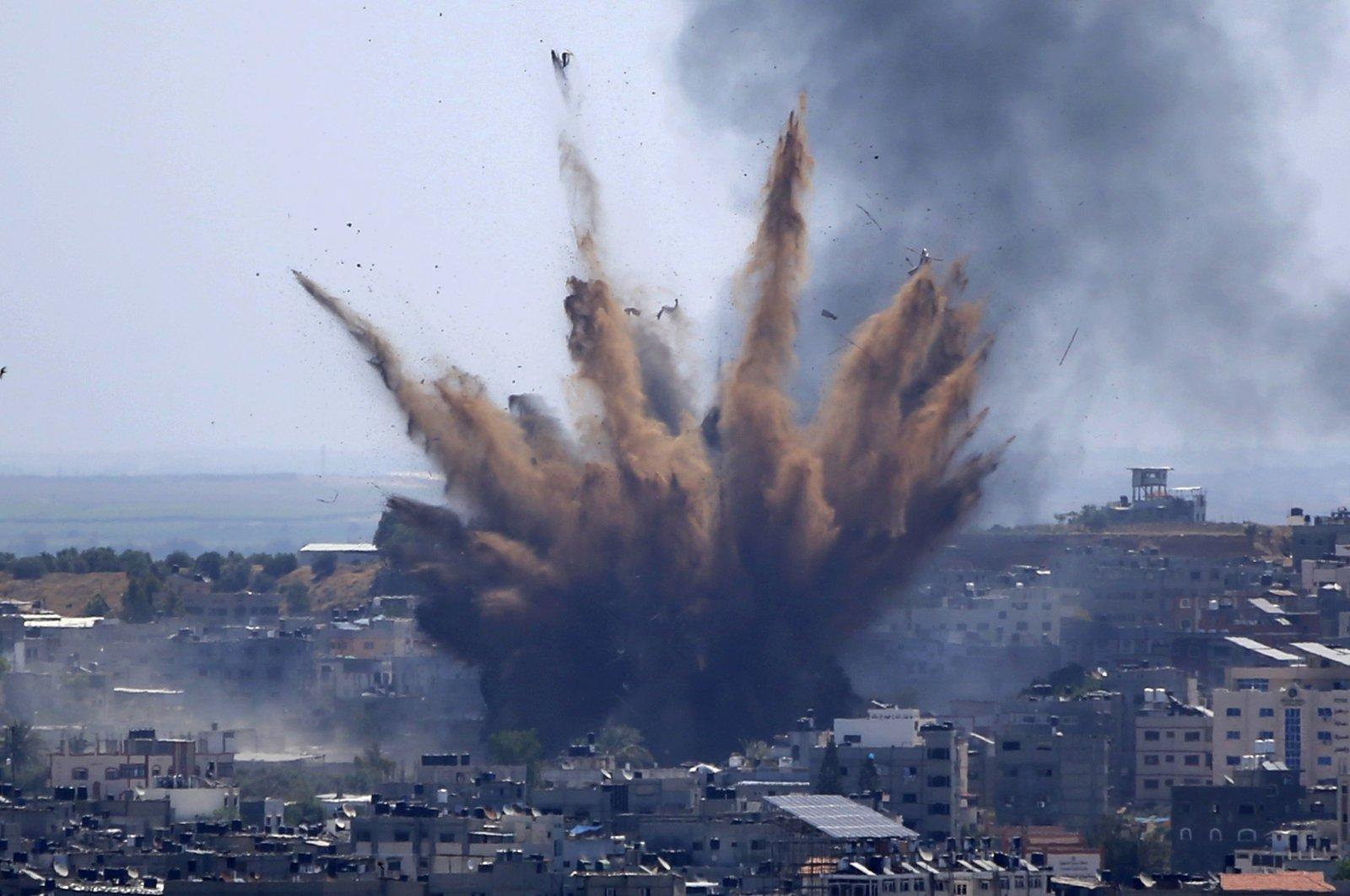 Smoke rises following Israeli airstrikes on a building in Gaza City, the Gaza Strip, Palestine, May 13, 2021. (AP Photo)