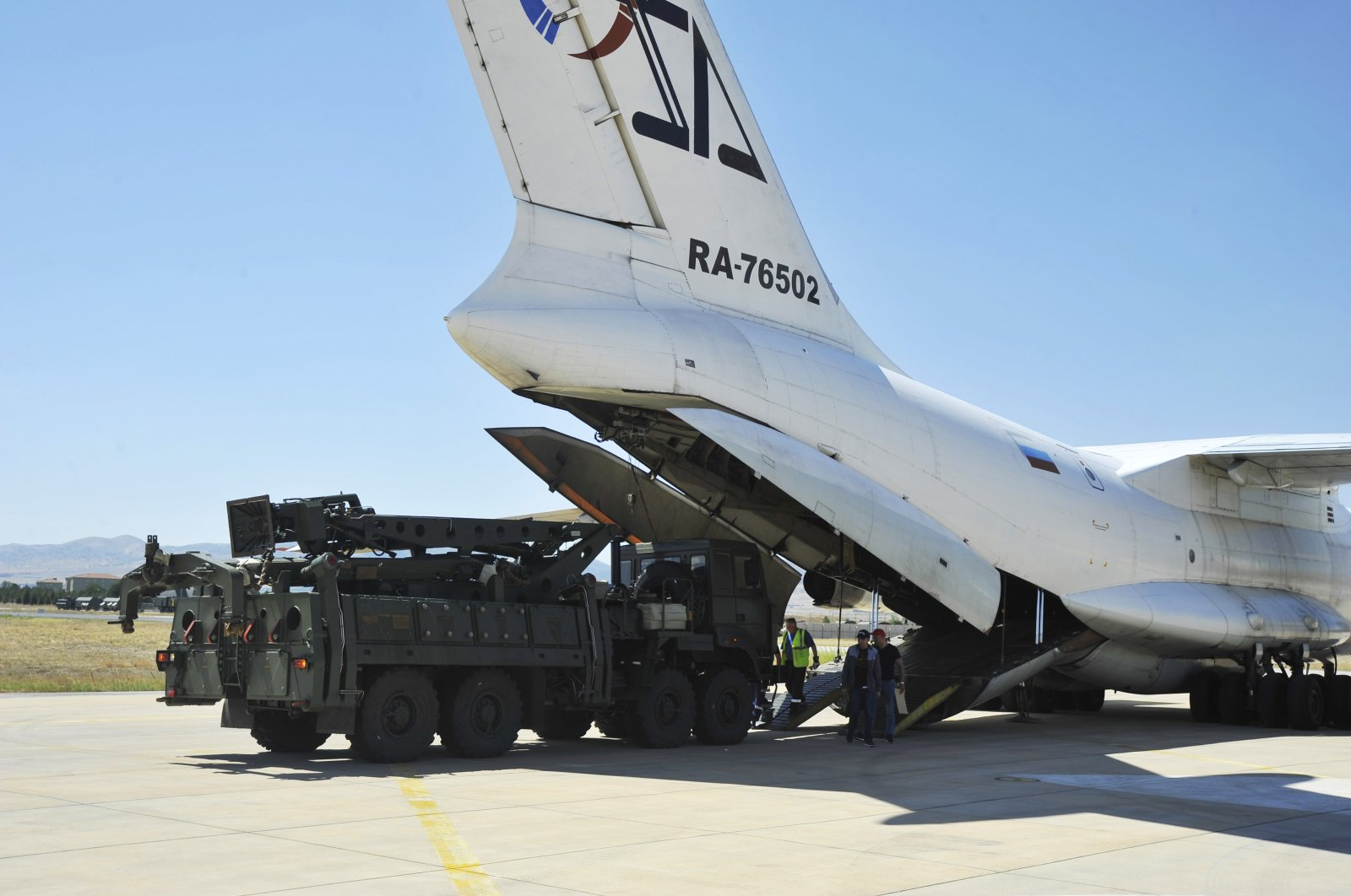 A Russian transport aircraft, carrying parts of the S-400 air defense systems, lands at Murted military airport outside Ankara, Turkey, Aug. 27, 2019. (Turkish Defense Ministry via AP)