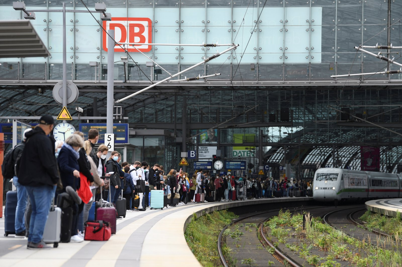 People wait for an arriving train on a platform at Berlin's main railway station during a nationwide rail workers' strike, in Berlin, Germany, Aug. 23, 2021. (Reuters Photo)