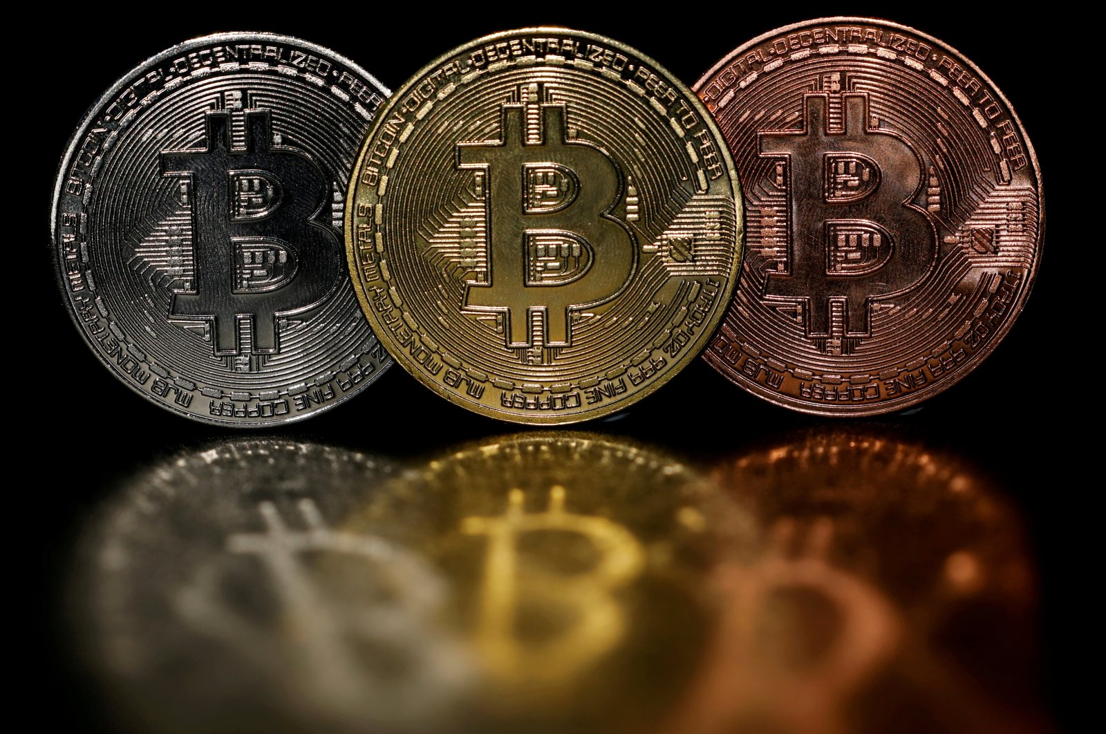 Representations of cryptocurrency bitcoin are seen in this picture illustration taken June 7, 2021. (Reuters Photo)