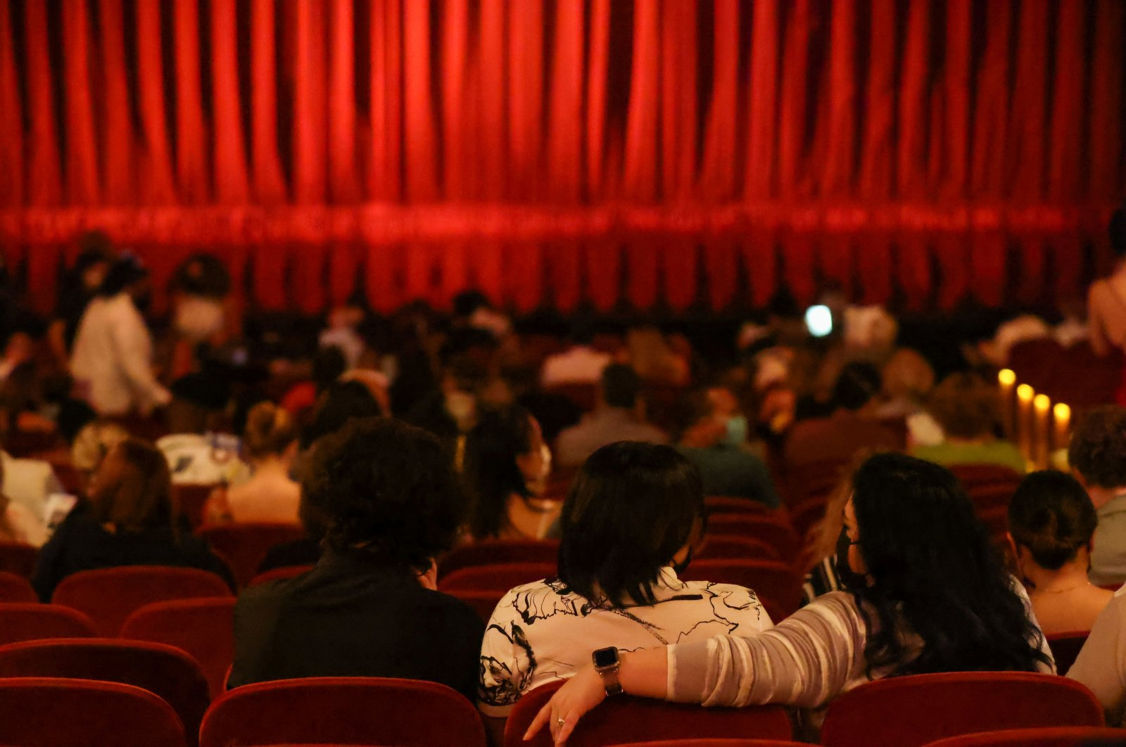 """Guests wait in their seats on the opening night of previews for """"Pass Over,"""" following the 17-month shutdown of Broadway due to COVID-19, at the August Wilson Theater in New York City, U.S., Aug. 4, 2021. (Reuters Photo)"""