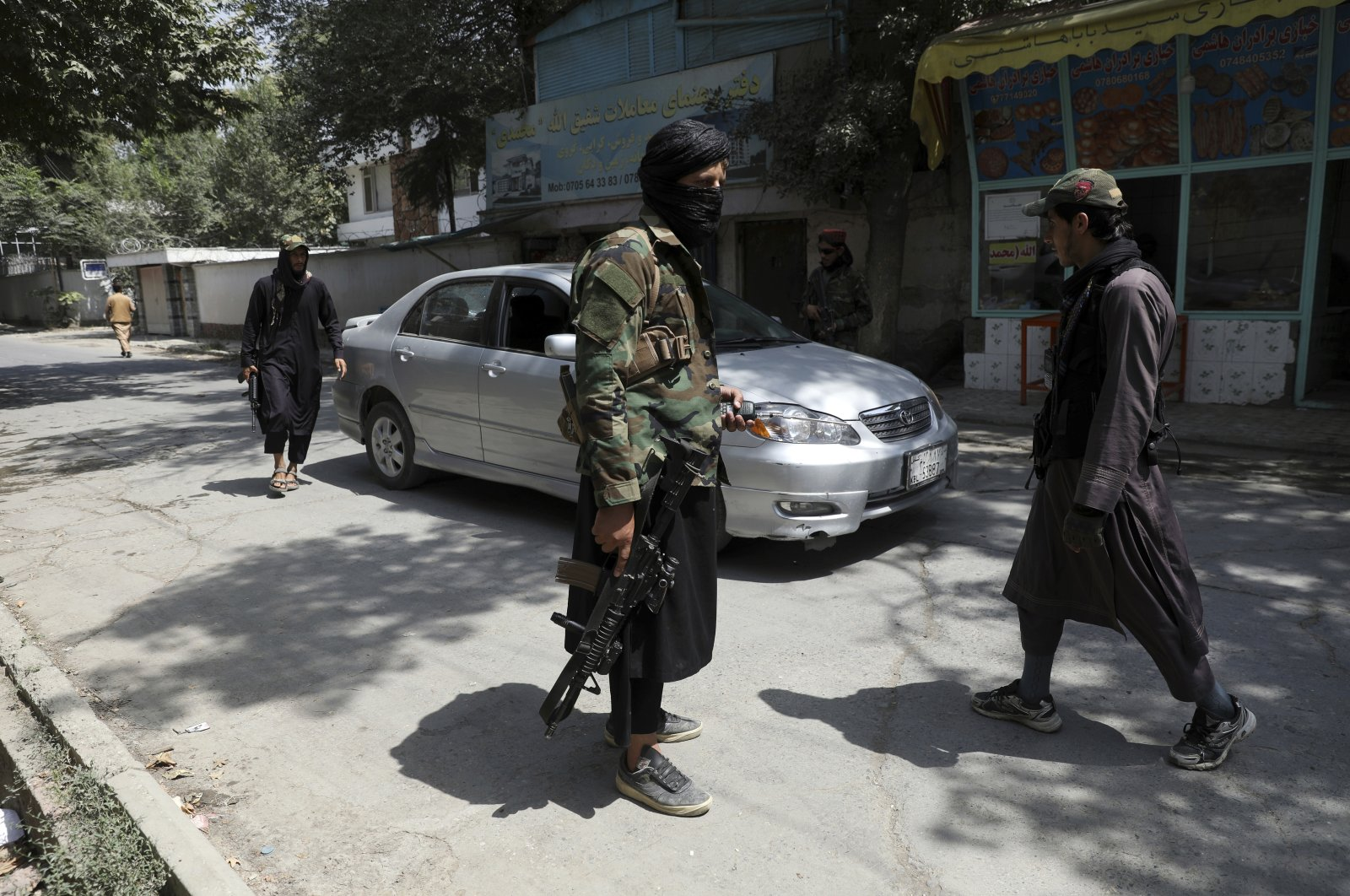 Taliban fighters stand guard at a checkpoint in the Wazir Akbar Khan neighborhood in the city of Kabul, Afghanistan, Aug. 22, 2021. (AP Photo)