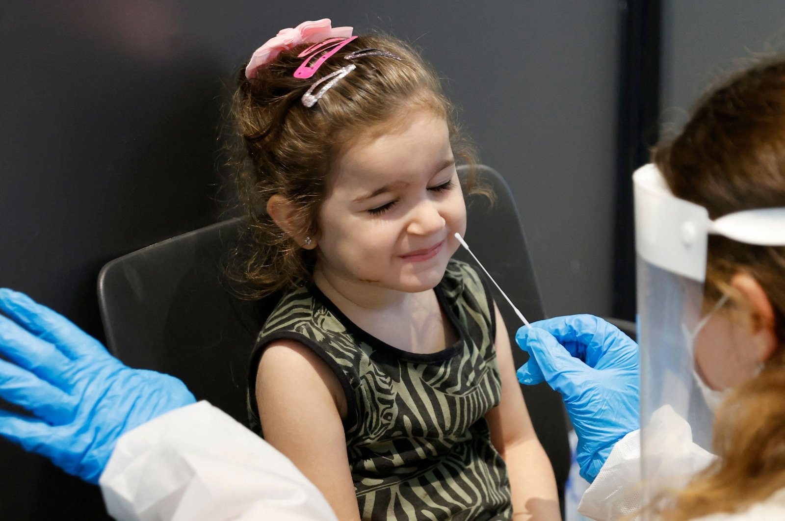 """An Israeli child undergoes an antigen test in order to visit the """"LEGO Space Park"""" exhibition in the Israeli coastal city of Tel Aviv, Aug. 19, 2021. (AFP Photo)"""