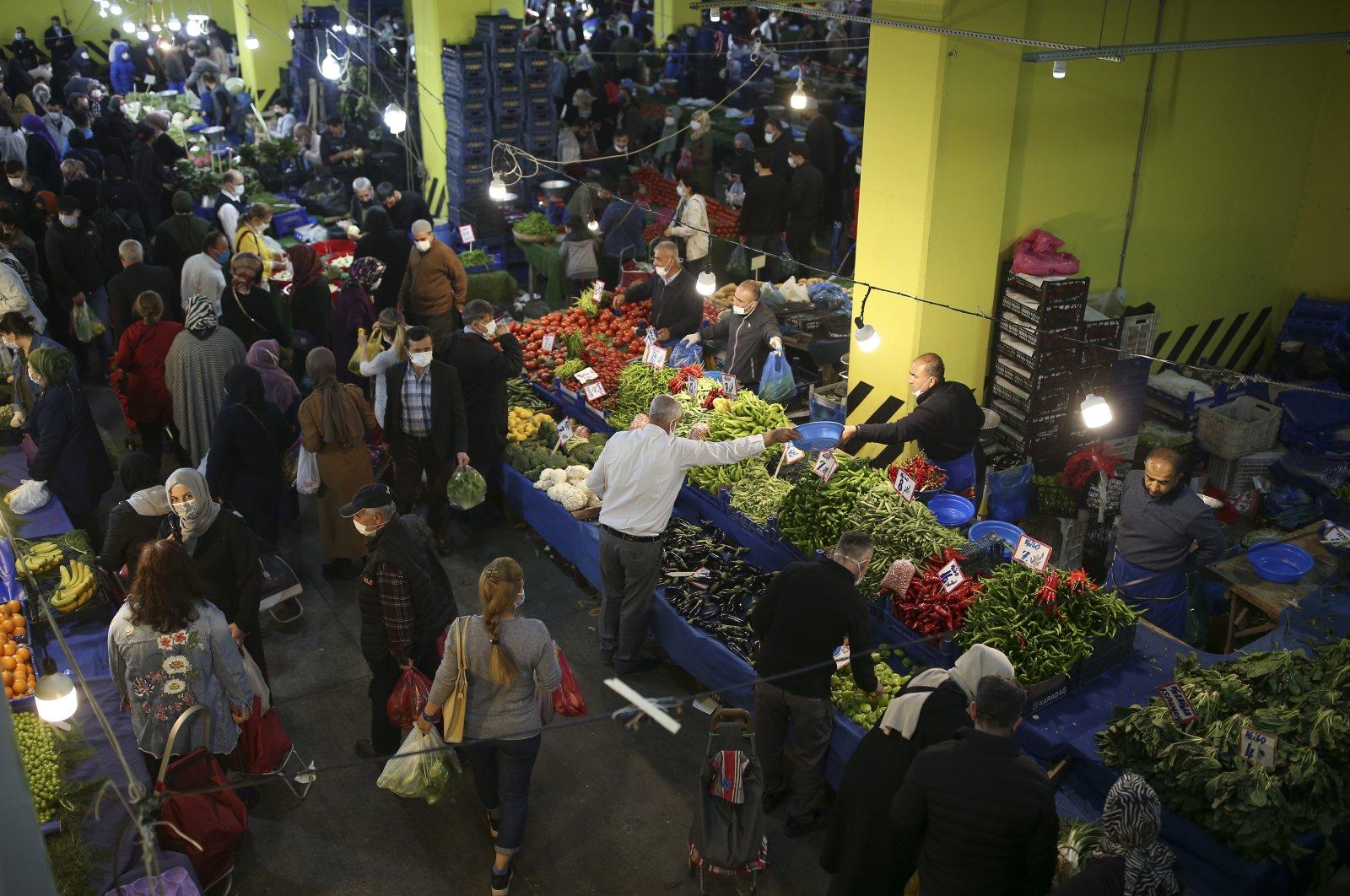 People shop in a street market in Istanbul, Turkey, April 29, 2021. (AP Photo)