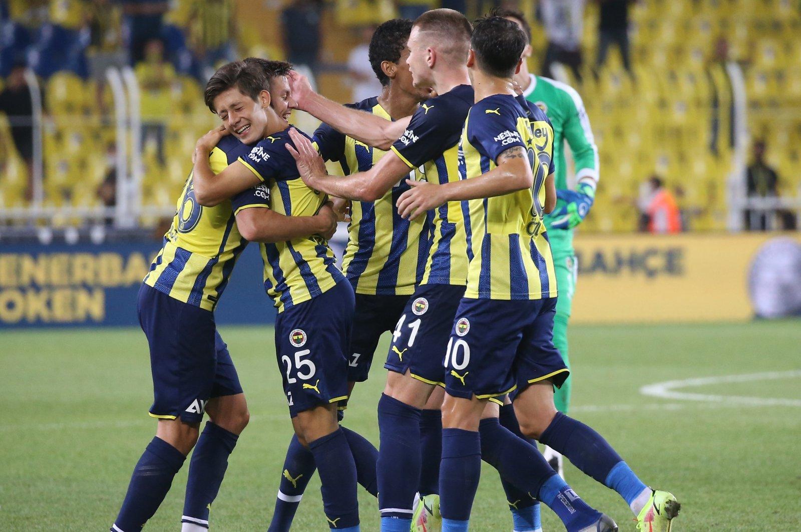 Fenerbahçe players celebrate a goal in a Turkish Süper Lig match against Antalyaspor, Istanbul, Turkey, Aug. 22, 2021.