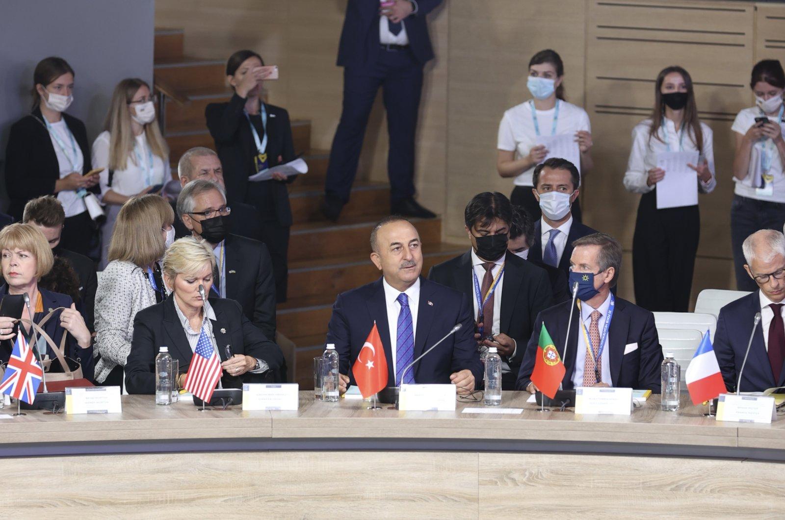 Foreign Minister Mevlüt Çavuşoğlu (C) represents Turkey at the Crimean Platform Summit in Kyiv, Ukraine, Aug. 23, 2021. (AA Photo)