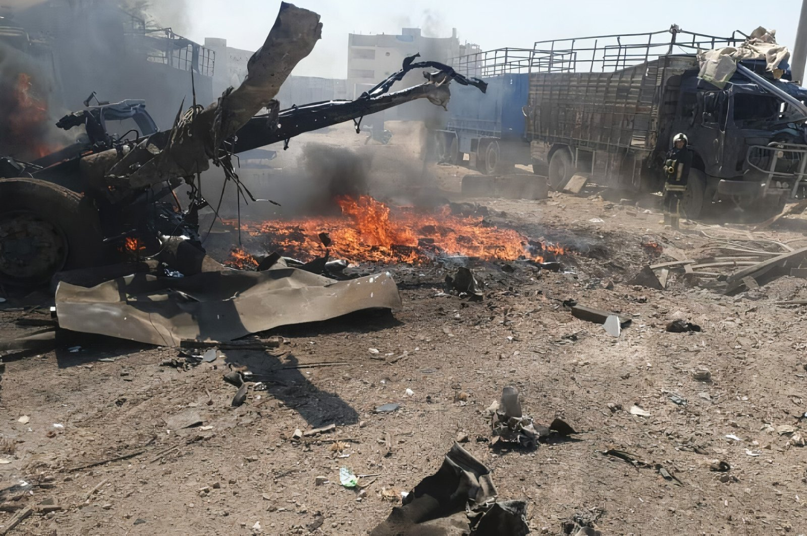 Remnants of a vehicle are seen after a car bomb explosion in Syria's Azaz, Aug. 23, 2021. (IHA Photo)