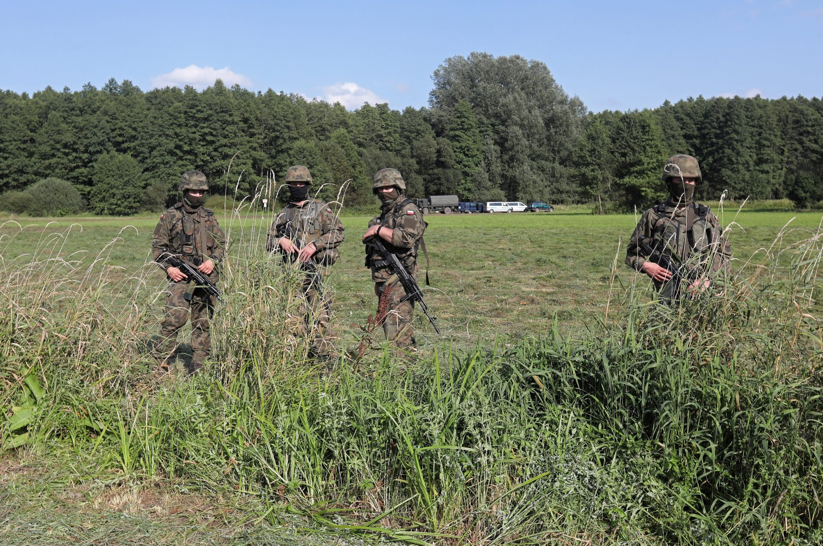 The Border Guard and the army near the town of Usnarz Gorny, northwest Poland, Aug. 22, 2021. (EPA Photo)