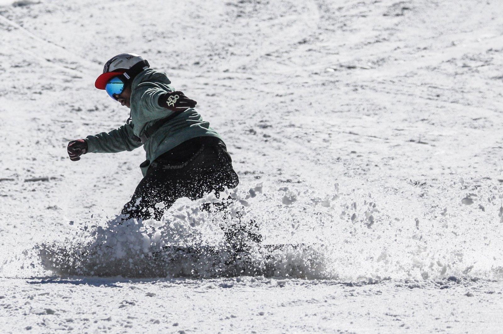 Hope Ramokotjo snowboards at Kapoko Snow Park at Afriski Mountain Resort in Butha Buthe, Lesotho, July 31, 2021. (Reuters Photo)