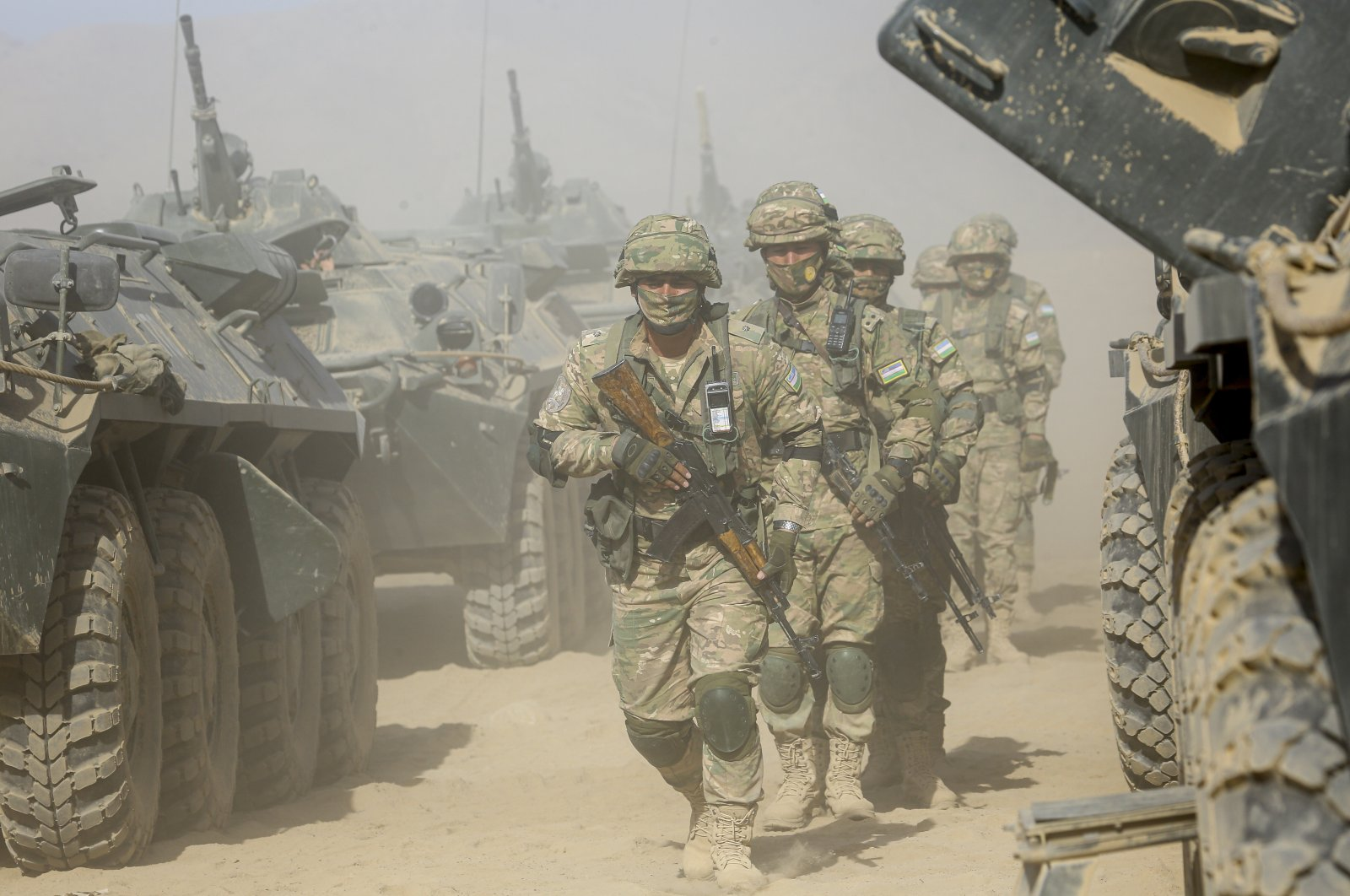 Uzbekistan's troops attend joint military drills with soldiers from Russia and Tajikistan at Harb-Maidon firing range about 20 kilometers (about 12 miles) north of the Tajik border with Afghanistan, in Tajikistan, Aug. 10, 2021. (AP Photo)
