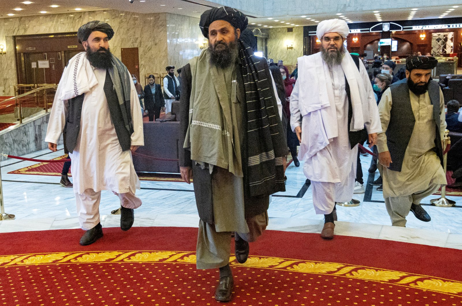 Mullah Abdul Ghani Baradar, the Taliban's deputy leader and negotiator, and other delegation members attend the Afghan peace conference in Moscow, Russia, March 18, 2021. (REUTERS/File Photo)