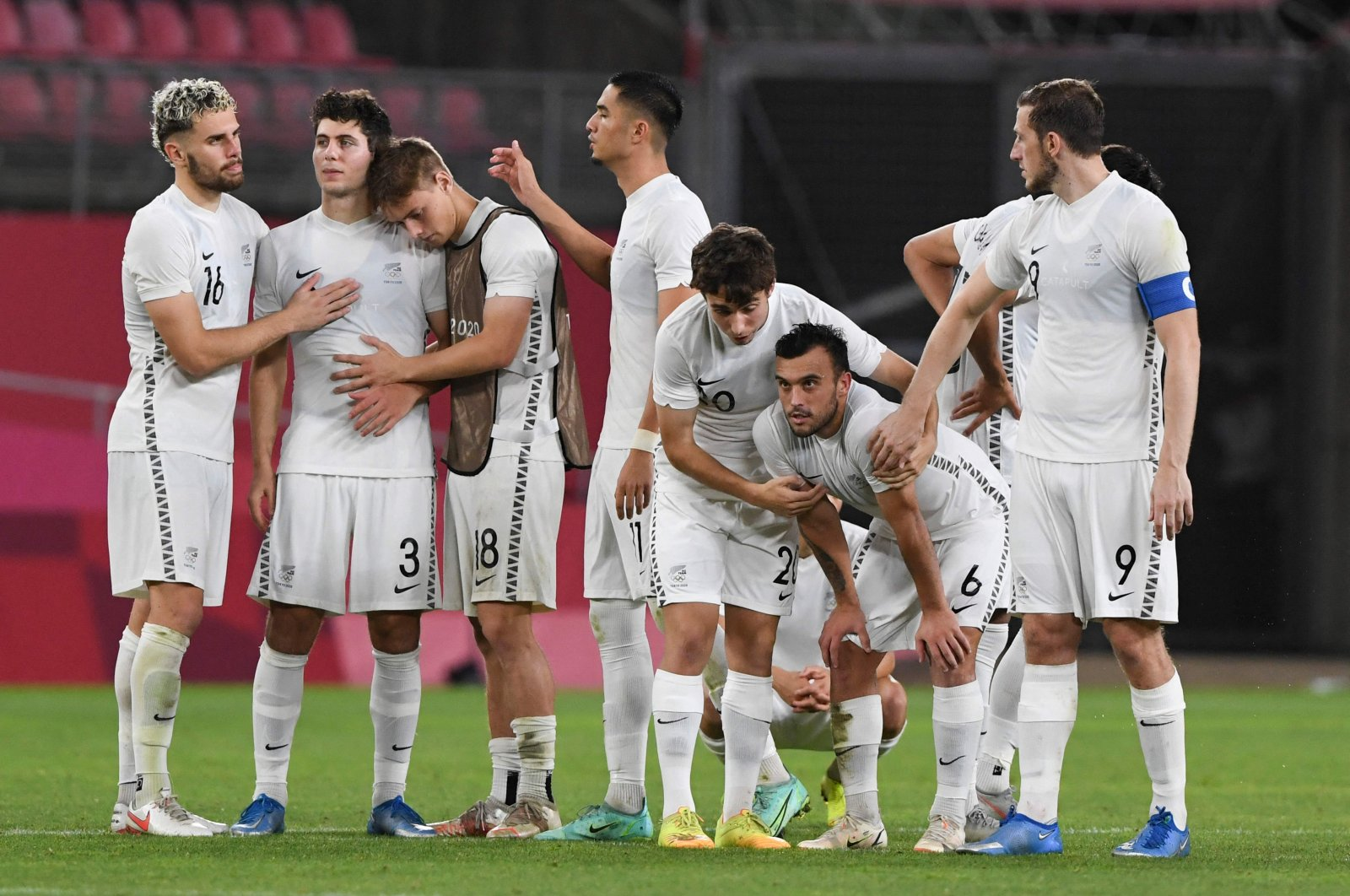 New Zealand players react to their defeat in the Tokyo 2020 Olympic Games men's quarterfinal against Japan at Ibaraki Kashima Stadium in Kashima, Ibaraki prefecture, July 31, 2021. (AFP Photo)