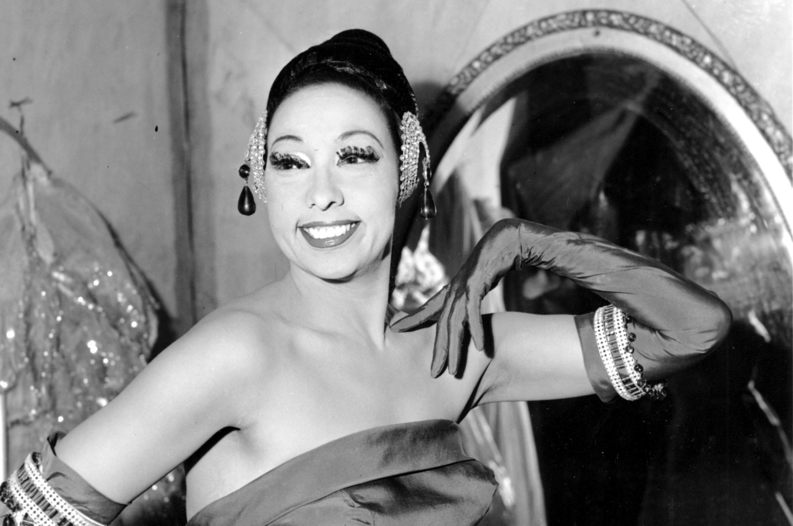 Singer Josephine Baker poses in her dressing room at the Strand Theater in New York City, U.S., March 6, 1961. (AP Photo)