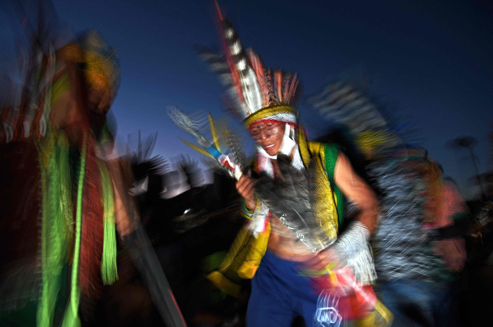 A member of the Huni Kuin tribe takes part in a ceremony at a protest camp in Brasilia, Brazil, Aug. 22, 2021. (AFP Photo)