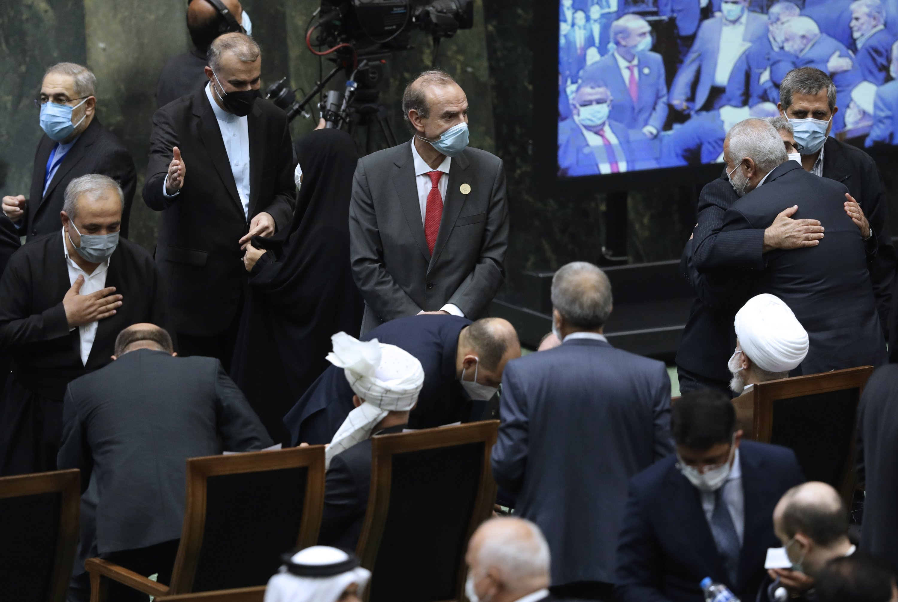 Deputy Secretary General and Political Director of the European External Action Service (EEAS) Enrique Mora (C) arrives to attend the swearing-in ceremony of Iranian President Ebrahim Raisi at the parliament in Tehran, Iran, Aug. 5, 2021. (AP Photo)