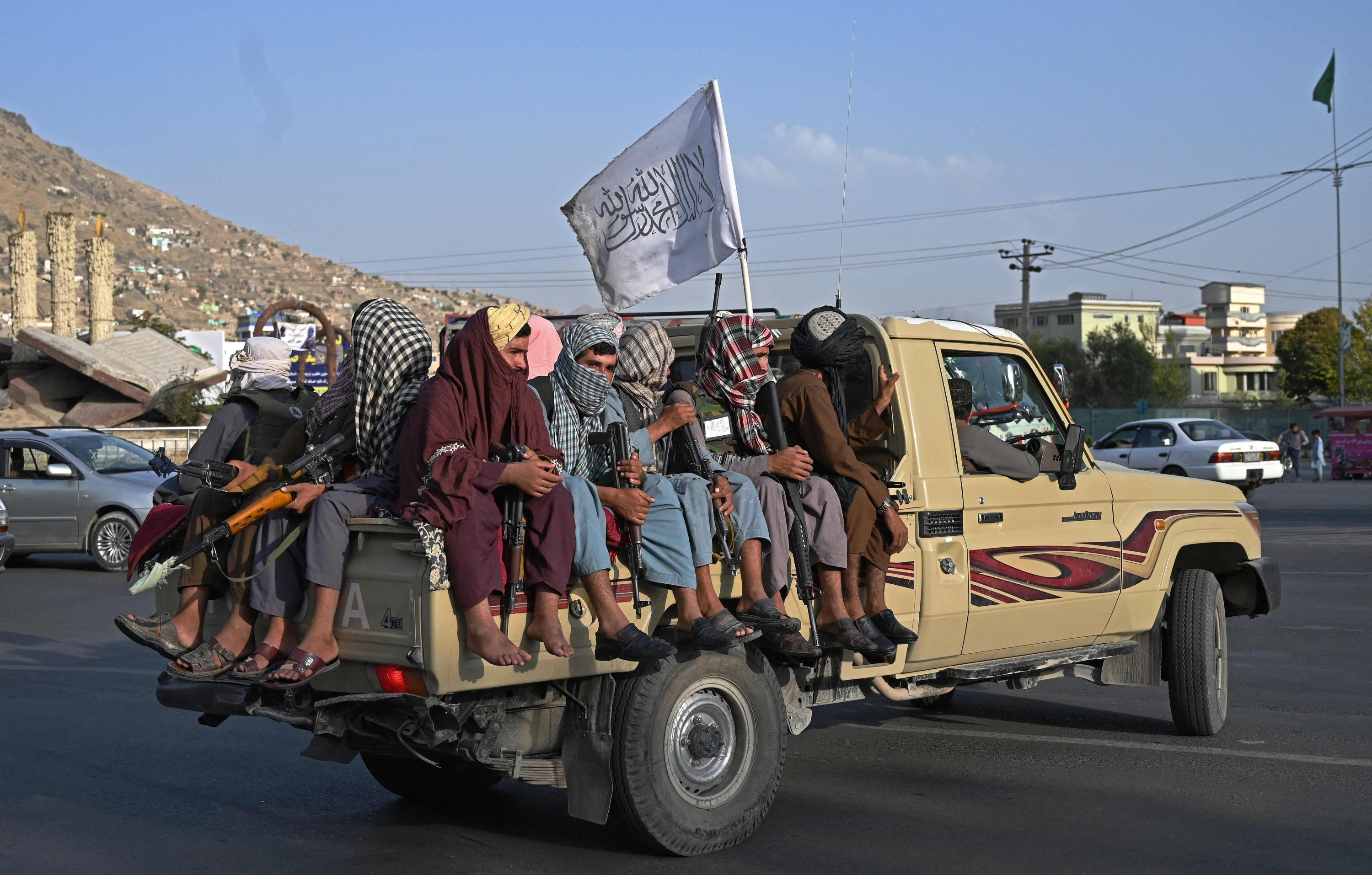 Taliban fighters in a vehicle patrol the streets of Kabul on Aug. 23, 2021. (AFP Photo)