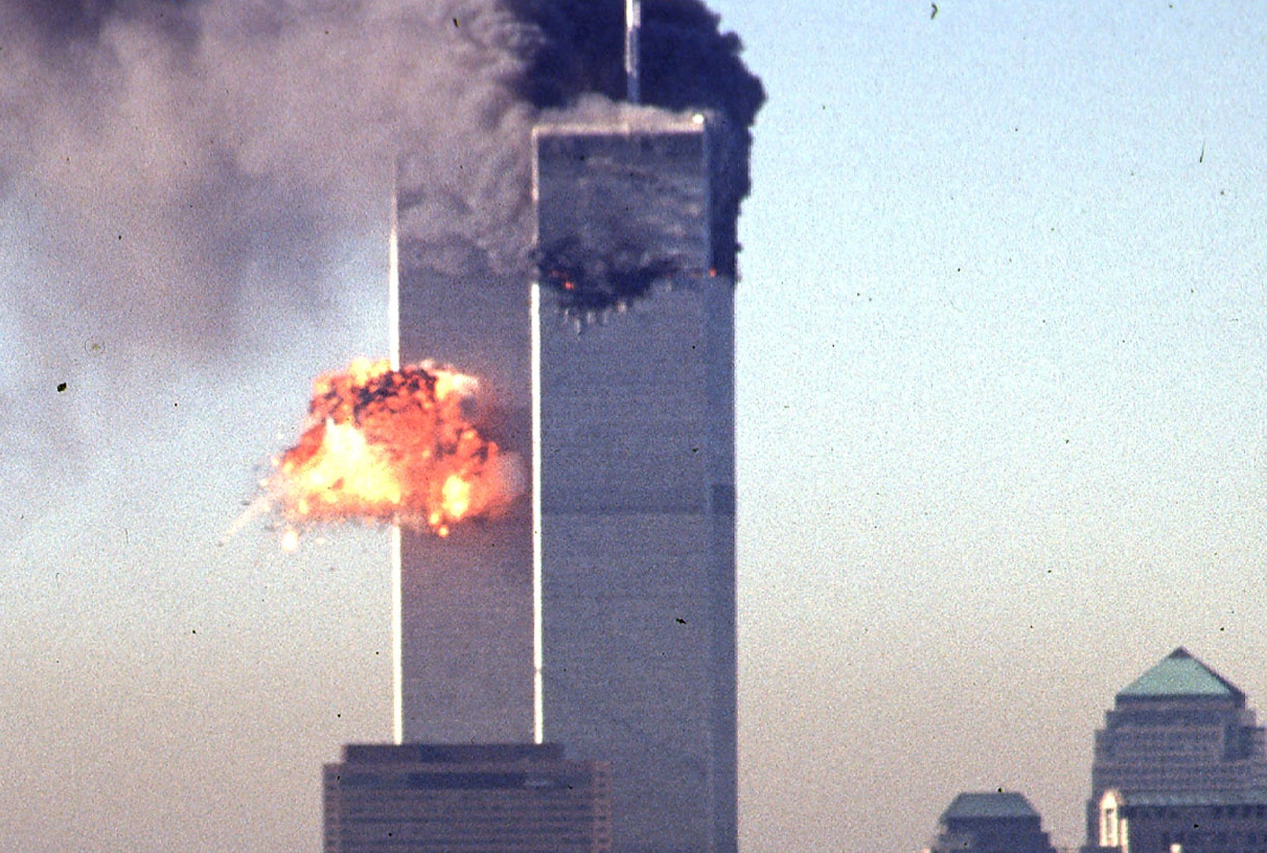 Smoke and flames erupt from the twin towers of the World Trade Center after commercial aircraft were deliberately crashed into the buildings in lower Manhattan, New York, U.S., on Sep. 11, 2001. (AFP Photo)