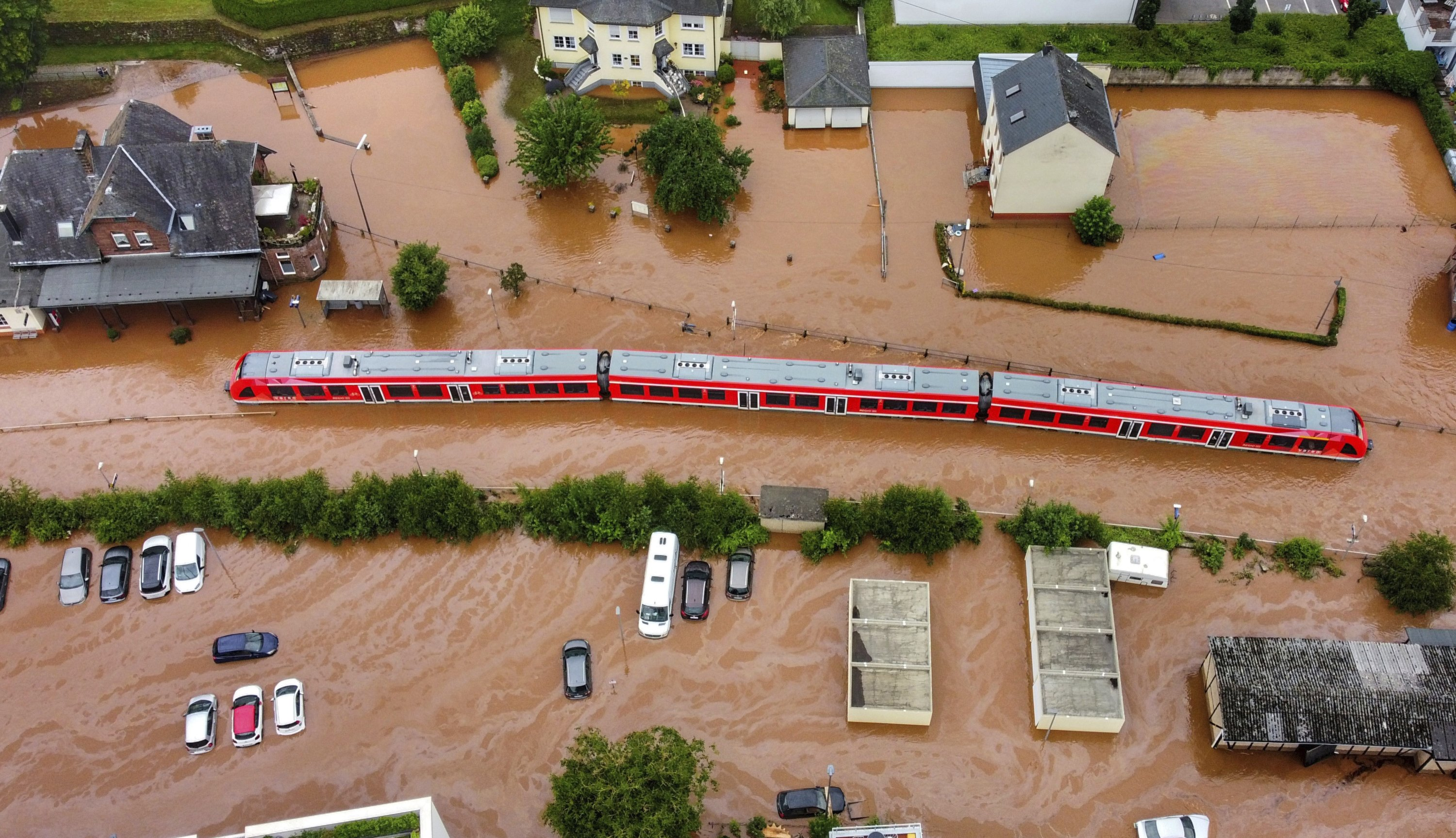 A regional train in the floodwaters at the local station in Kordel, after the town was flooded by the rising waters of the Kyll river, Germany, July 15, 2021. (AP Photo)