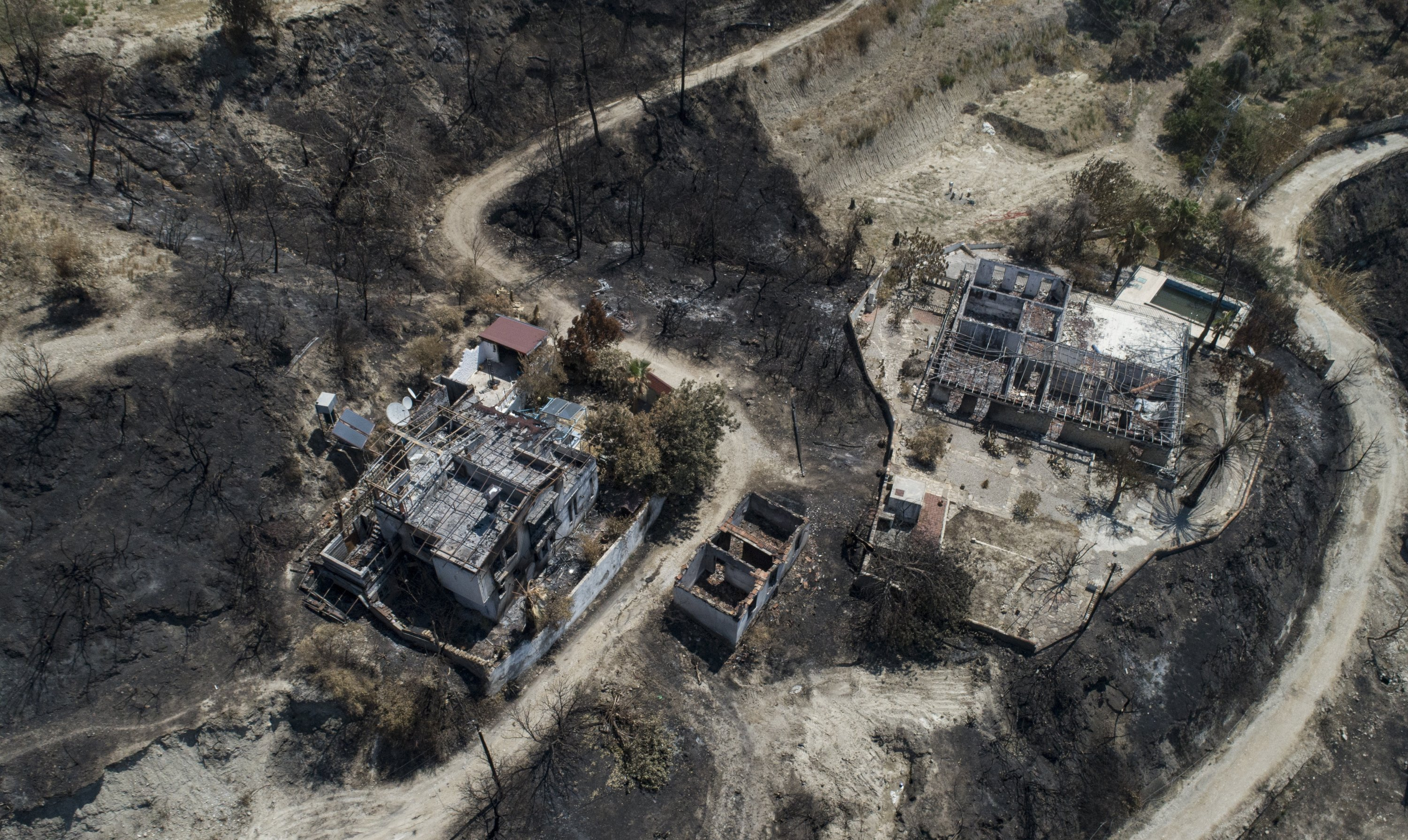An aerial view taken with a drone shows burned houses after a wildfire at the Kalemler village of the Manavgat district in Antalya, Turkey, Aug. 9, 2021. (EPA Photo)