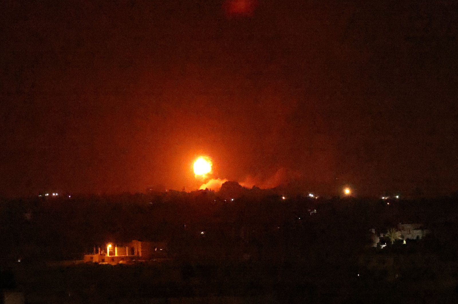 A fireball rises following an airstrike in Khan Yunis in the southern Gaza Strip, Palestine, Aug. 23, 2021. (AFP Photo)