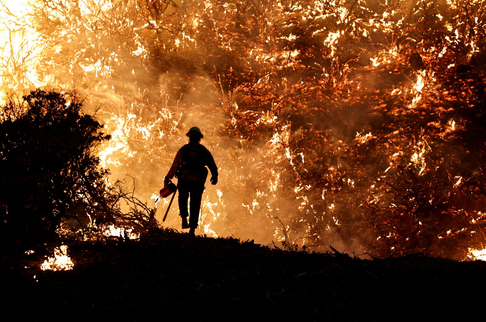 A firefighter battles the Caldor Fire in Grizzly Flats, California, U.S., Aug. 22, 2021. (REUTERS Photo)