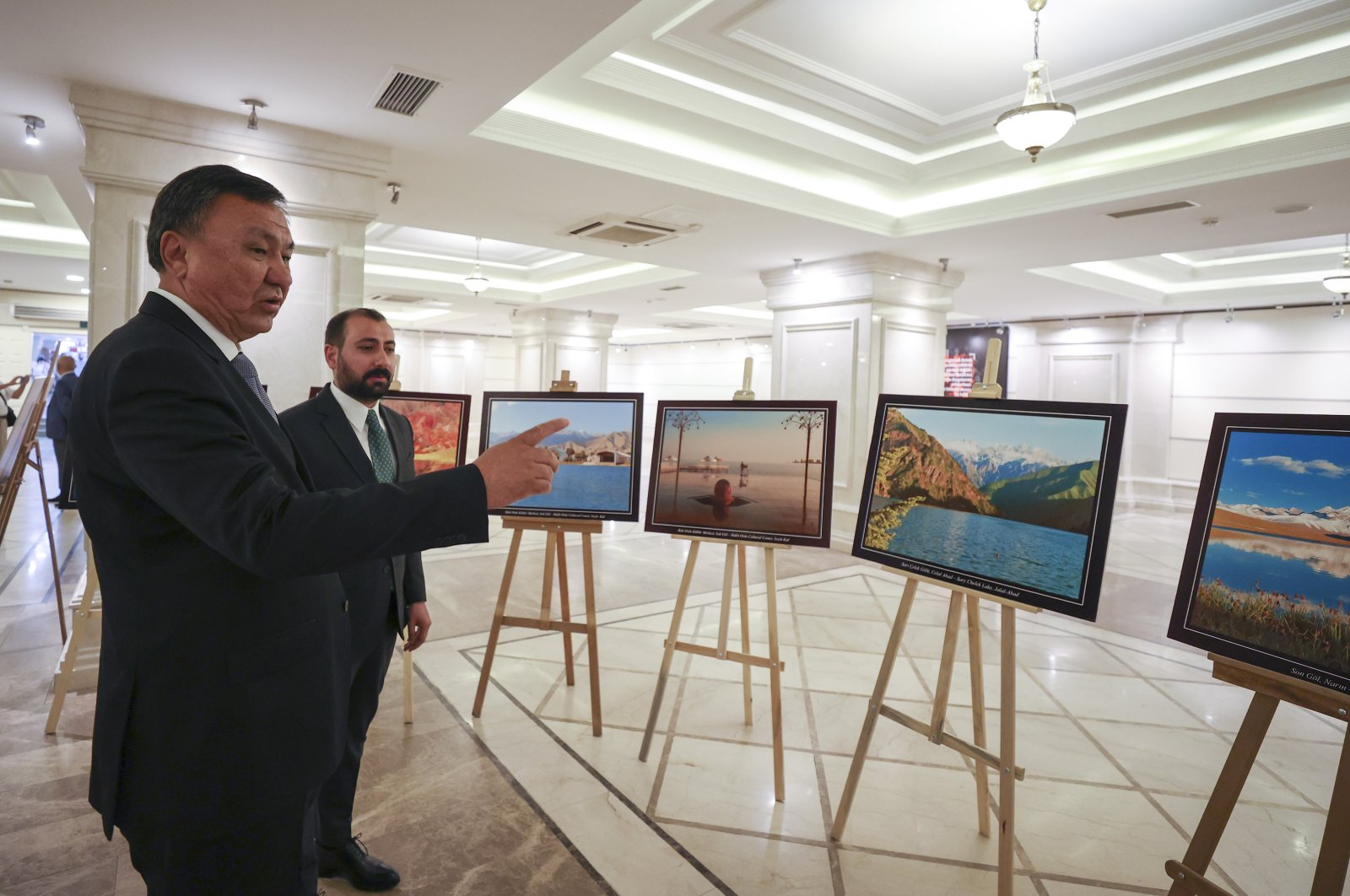 Kyrgyzstan's Ambassador Kubanychbek Omuraliev (L) visits an exhibition to mark the 30th anniversary of the Central Asian nation's independence in the capital Ankara, Turkey, Aug. 23, 2021. (AA Photo)