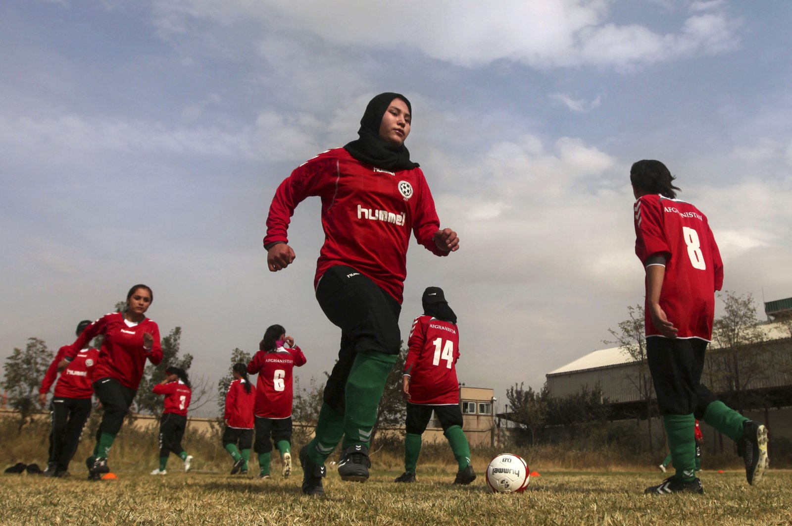 Members of the Afghan women's national football team warm-up before a friendly match against the ISAF (International Security Assistance Force) female football team at the ISAF headquarters in Kabul, Afghanistan, Oct. 29, 2010. (AP Photos)