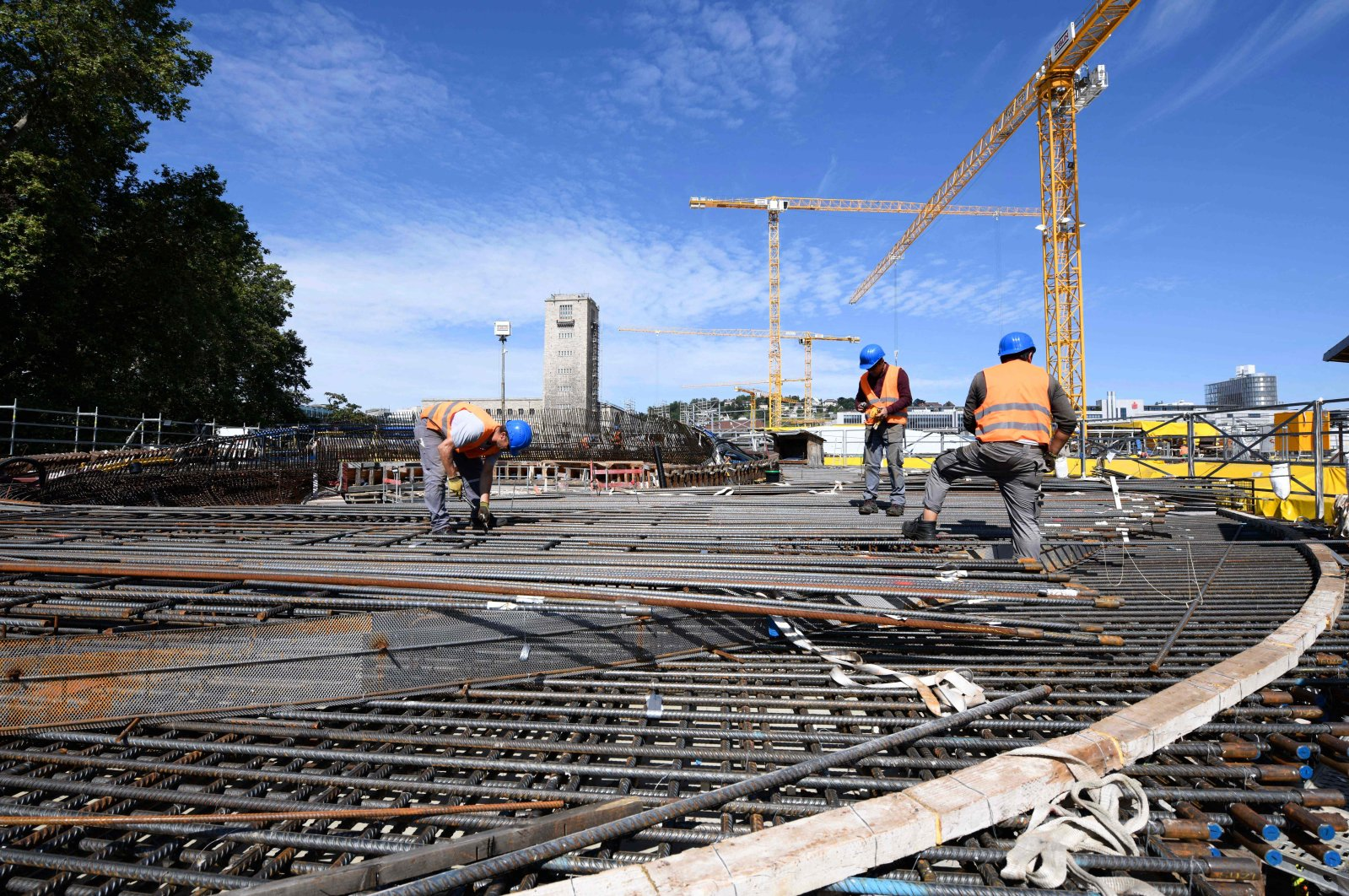 Workers build up a support for the platform hall on the construction site of the Stuttgart 21 railway project at the main station in Stuttgart, Germany, Aug. 9, 2021. (AFP Photo)