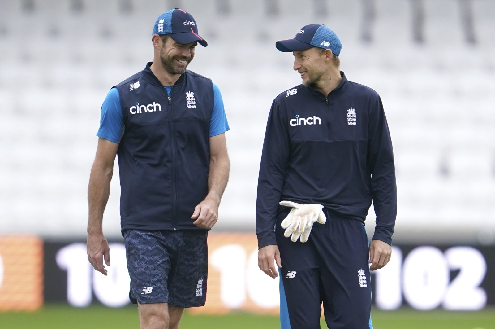 England's Joe Root (R) and James Anderson during a nets session before the 3rd Test against India at Headingley cricket ground, Leeds, England, Aug. 24, 2021. (AP Photo)