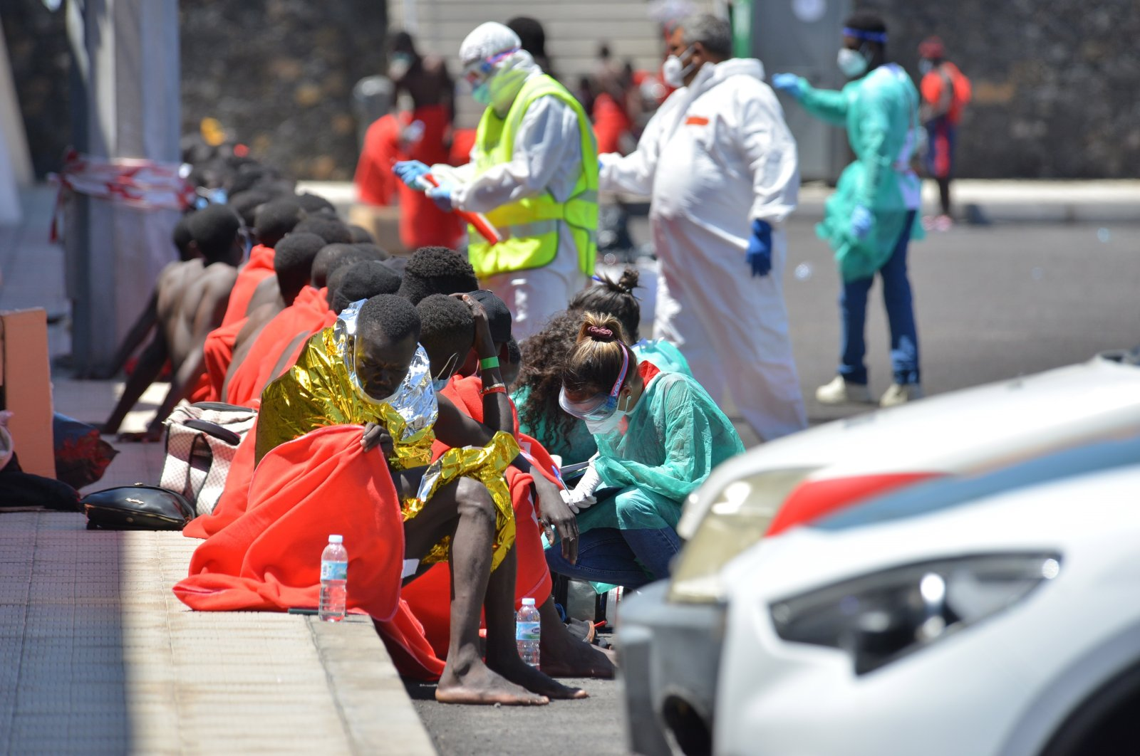 Red Cross members take care of migrants rescued at the La Restringa port in El Hierro, Canary Islands, Spain, Aug. 23, 2021. (EPA Photo)