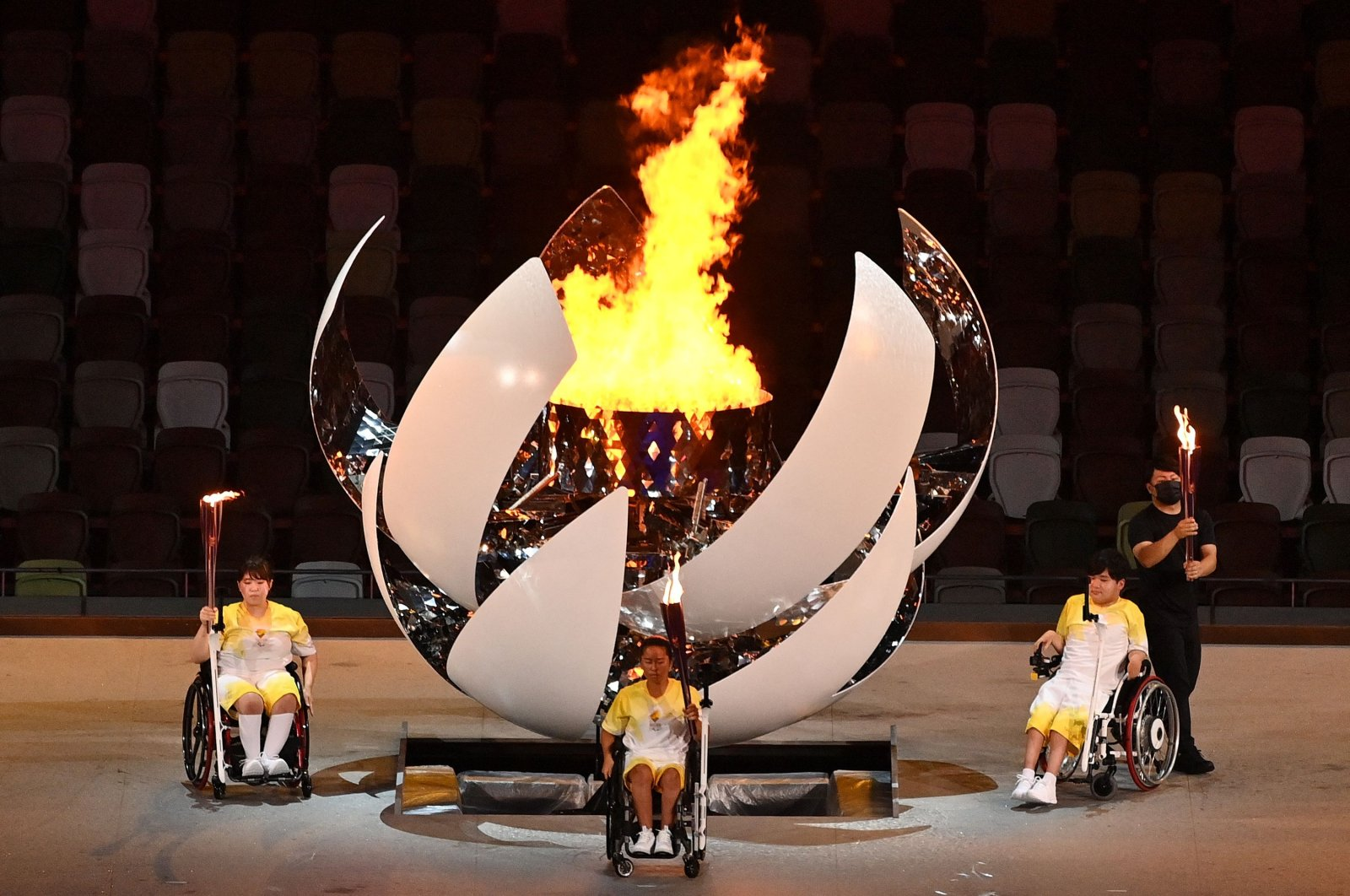 Three torchbearers pose after lighting the Paralympic cauldron during the opening ceremony for the Tokyo 2020 Paralympic Games at the Olympic Stadium in Tokyo, Japan, Aug. 24, 2021. (AFP Photo)