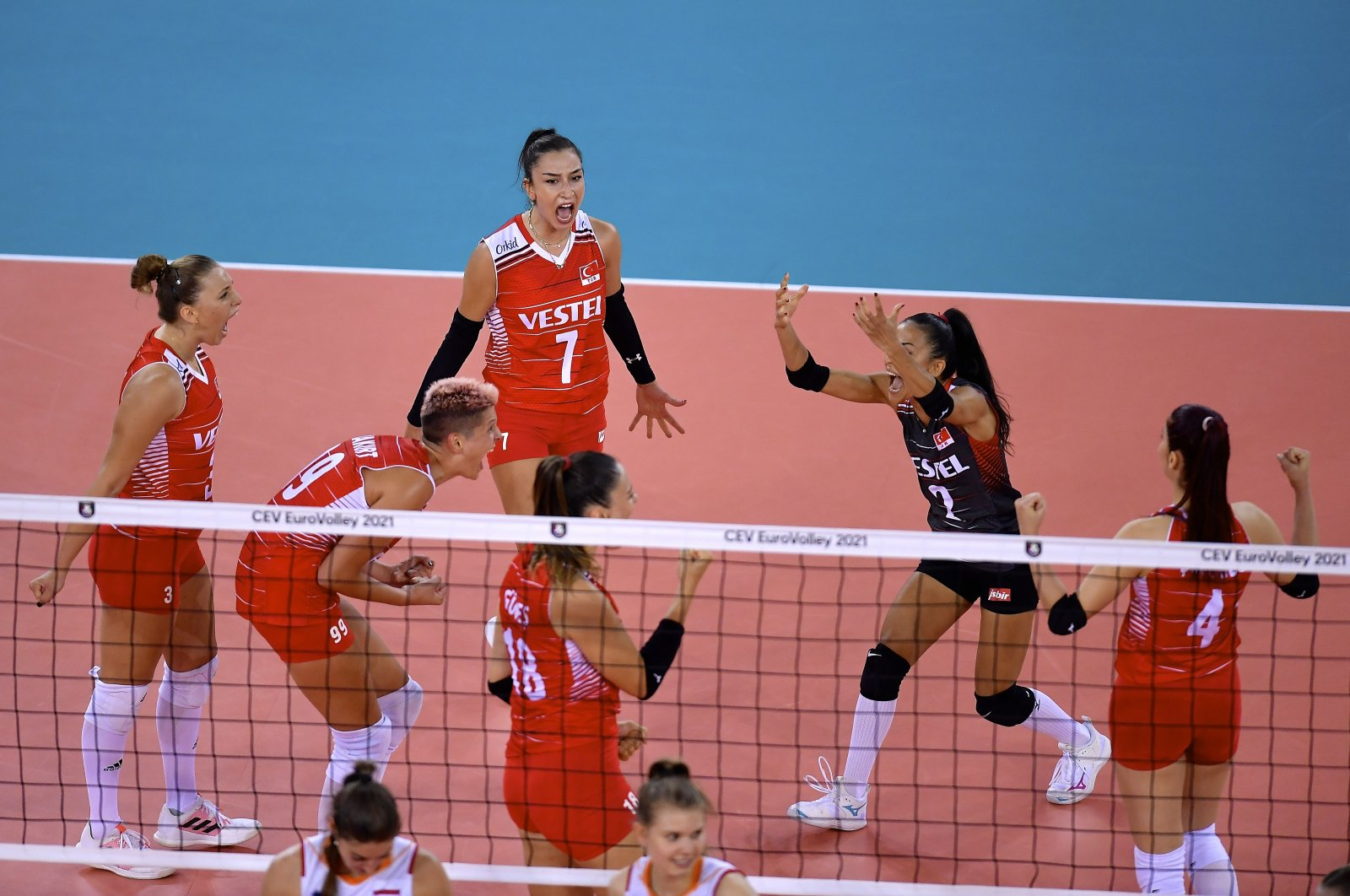 Turkish national volleyball team players celebrate after scoring during a EuroVolley 2021 group stage match at the BT Arena in Romania's Cluj-Napoca on Aug. 23, 2021 (AA Photo)