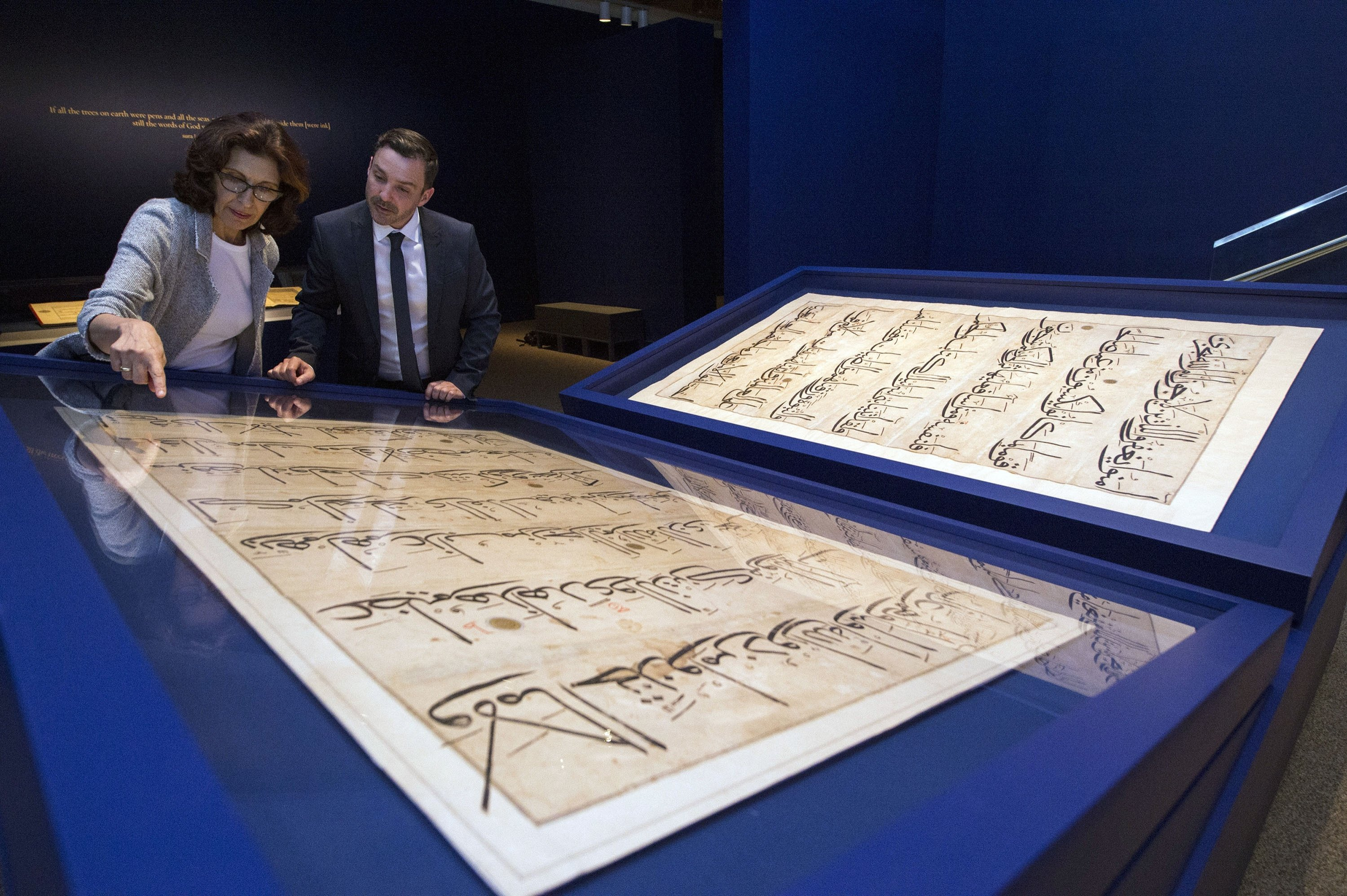 Curators of 'The Art of the Quran: Treasures from the Museum of Turkish and Islamic Arts' exhibit, look at pages from a 5-foot by 7-foot Quran, at the Sackler Gallery in Washington, U.S., Oct. 20, 2016. (AP Photo)
