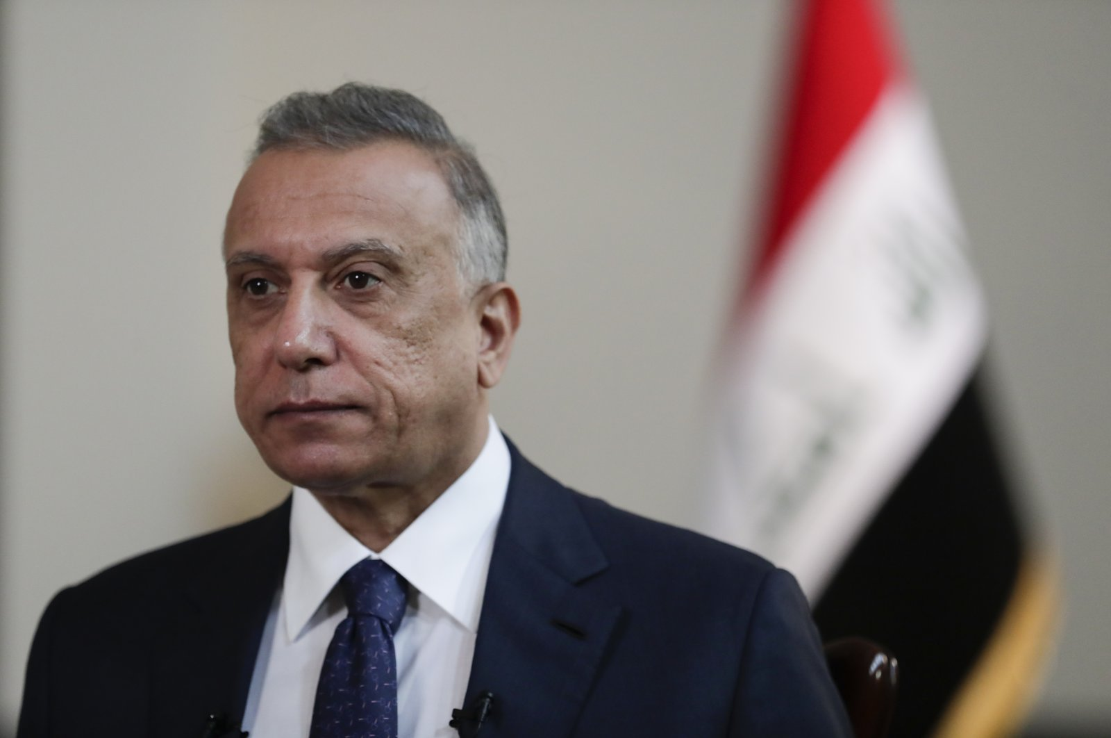 Iraqi Prime Minister Mustafa al-Kadhimi poses in his office during an interview in Baghdad, Iraq, July 23, 2021. (AP Photo)